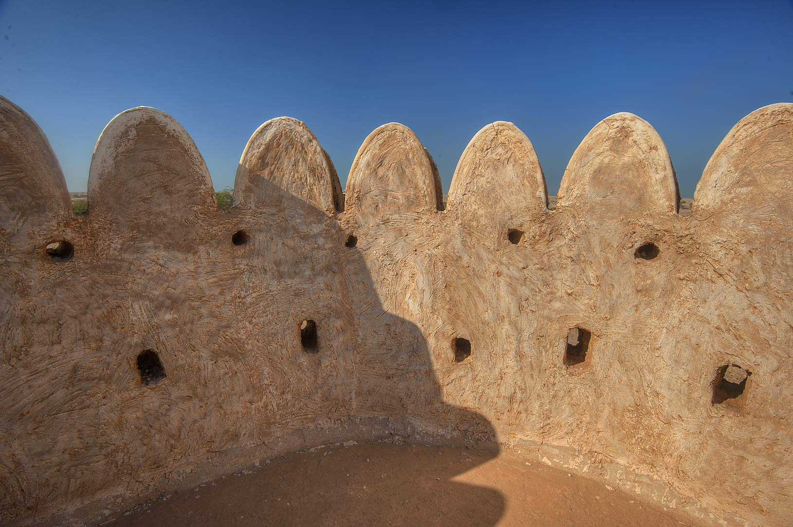 Stone fence of a tower of Al Thugab Fort, on northern coast. Qatar