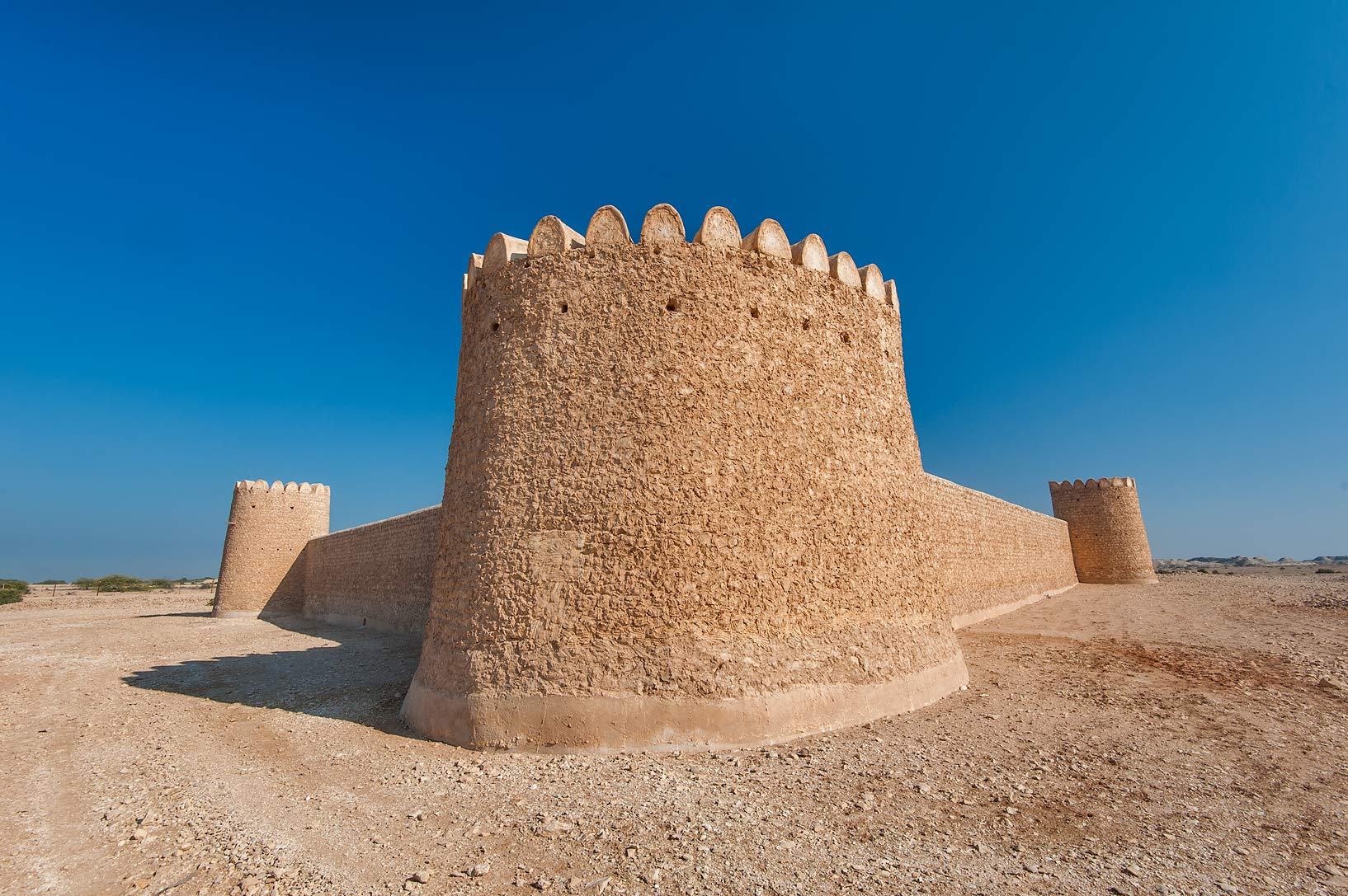 Wide round tower at the corner of Al Thugab Fort, on northern coast. Qatar