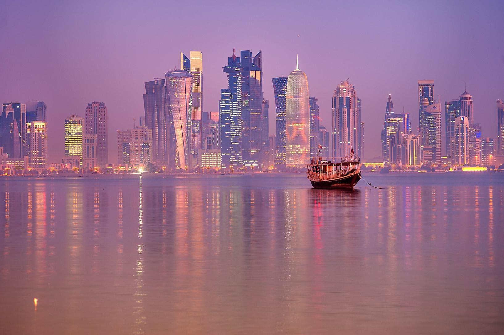 Dhow boat and West Bay, view from Corniche promenade. Doha, Qatar
