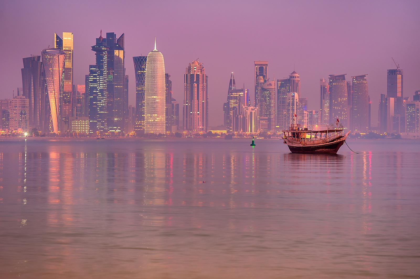 Dhow boat and West Bay in background, view from Corniche promenade. Doha, Qatar