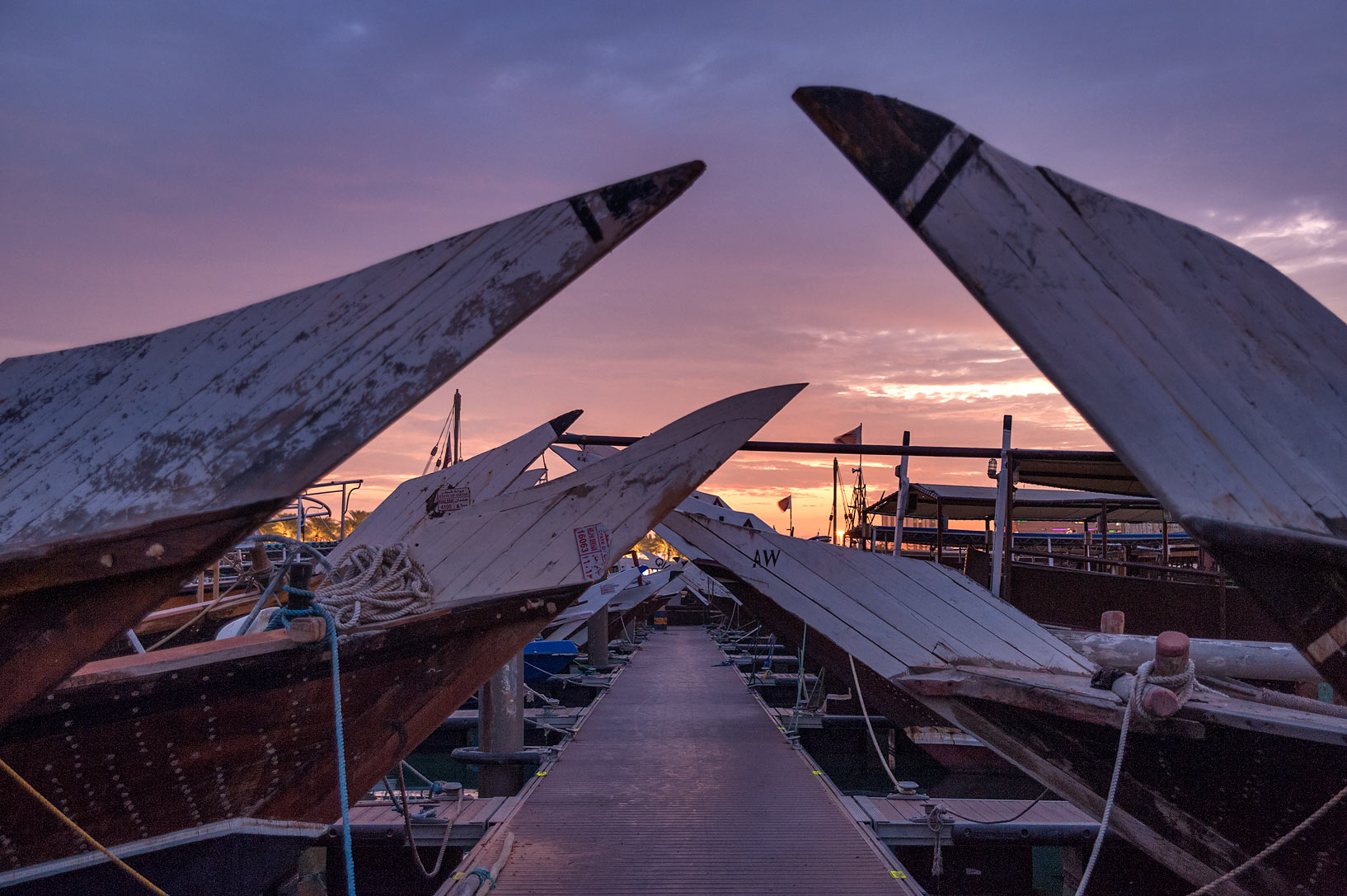 Dhow boats on a pier near Museum of Islamic Art. Doha, Qatar