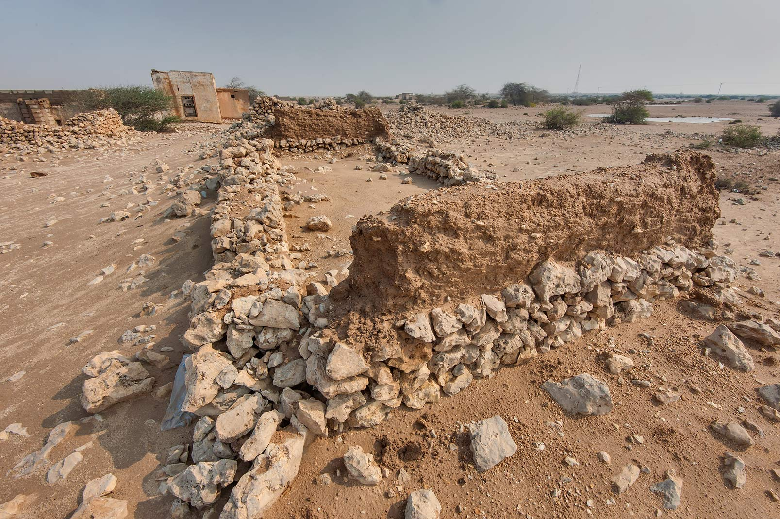 Washed out clay walls in Ain Mohamed Fort near Al...Rd. north from Zubara. Northern Qatar