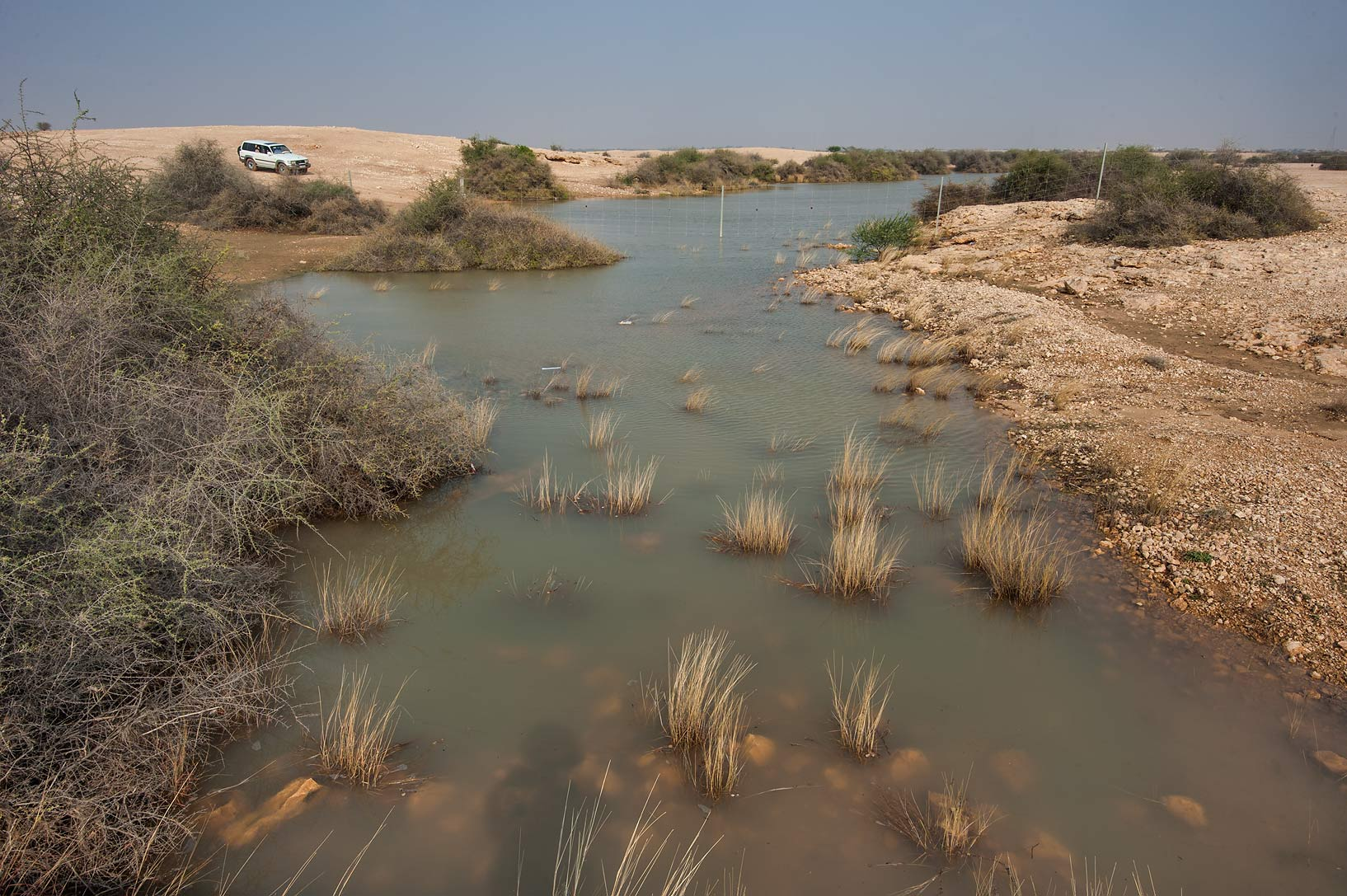 Water stream after a rain on roadside of a road...of Al Magdah farms. Northern Qatar