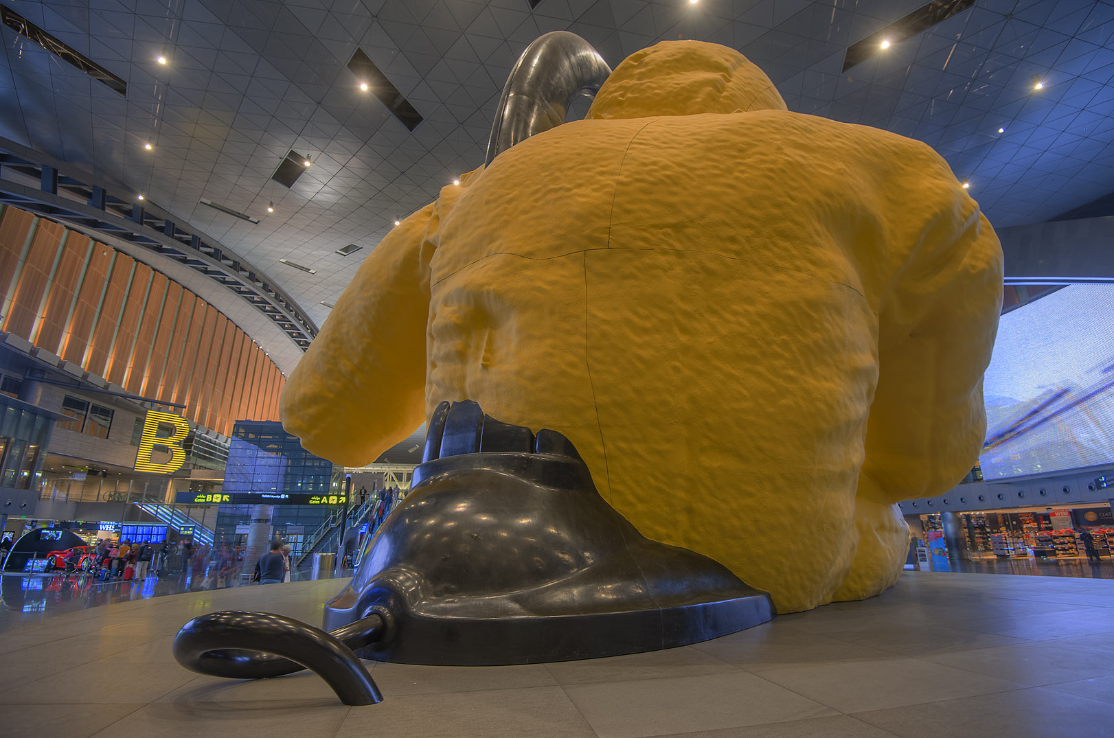 Back view of Lamp Bear sculpture by Urs Fischer...International Airport. Doha, Qatar