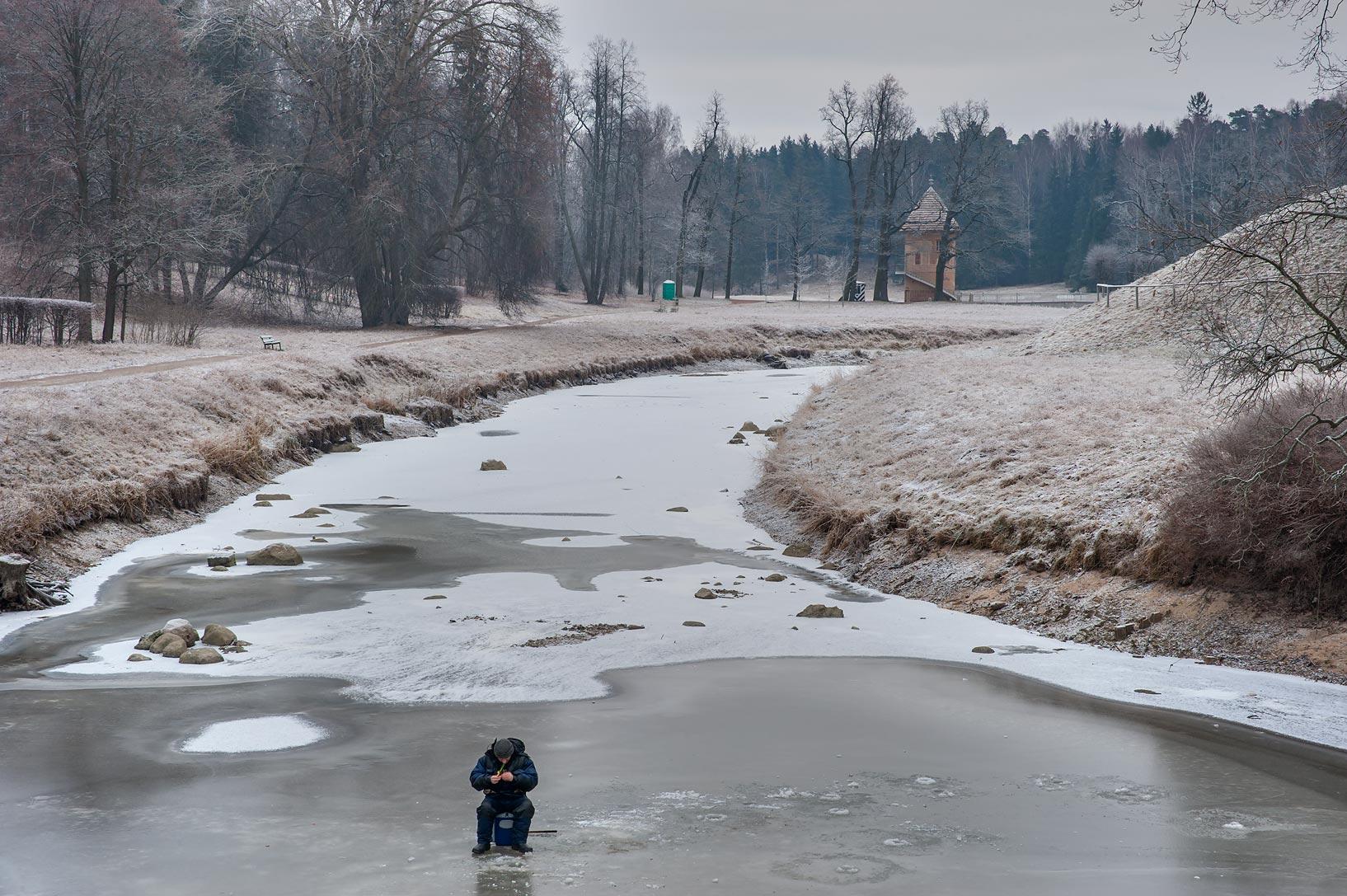 Ice fishing on Slavianka River in Pavlovsk Park. Pavlovsk, suburb of St.Petersburg, Russia