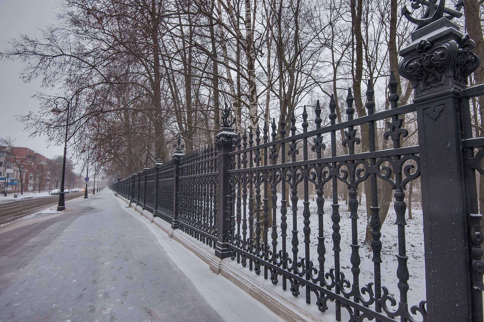 Cast iron fence of a garden on Petrovskaya St. in Kronstadt. St.Petersburg, Russia