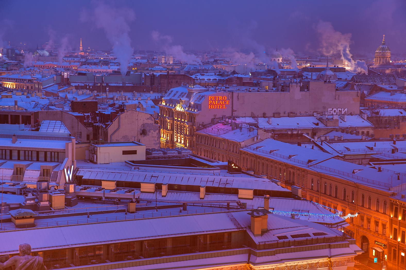 Snowy roofs and smokes from colonnade of St.Isaac Cathedral. St.Petersburg, Russia