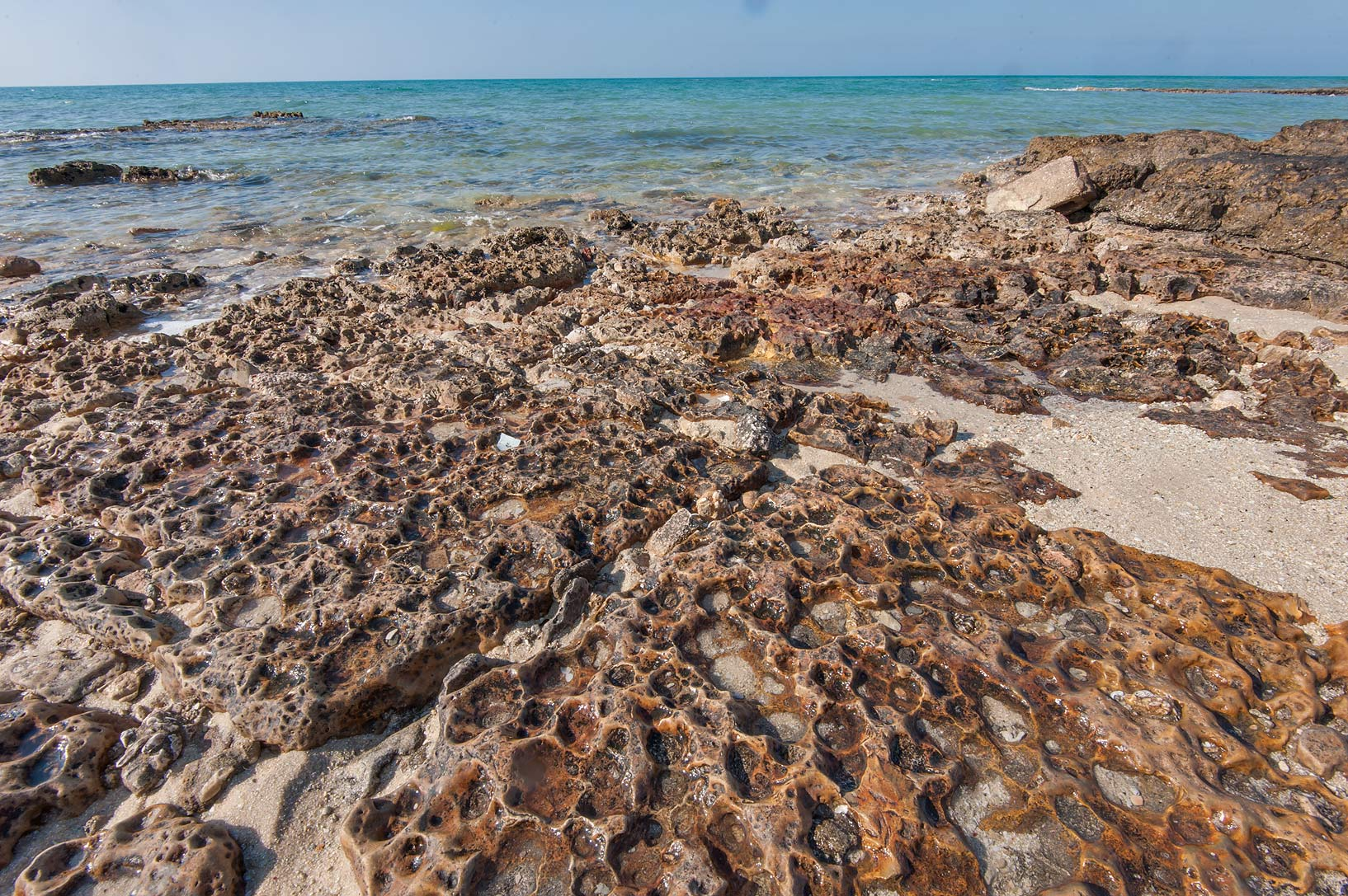 Texture of stones on a beach in Dukhan. Qatar