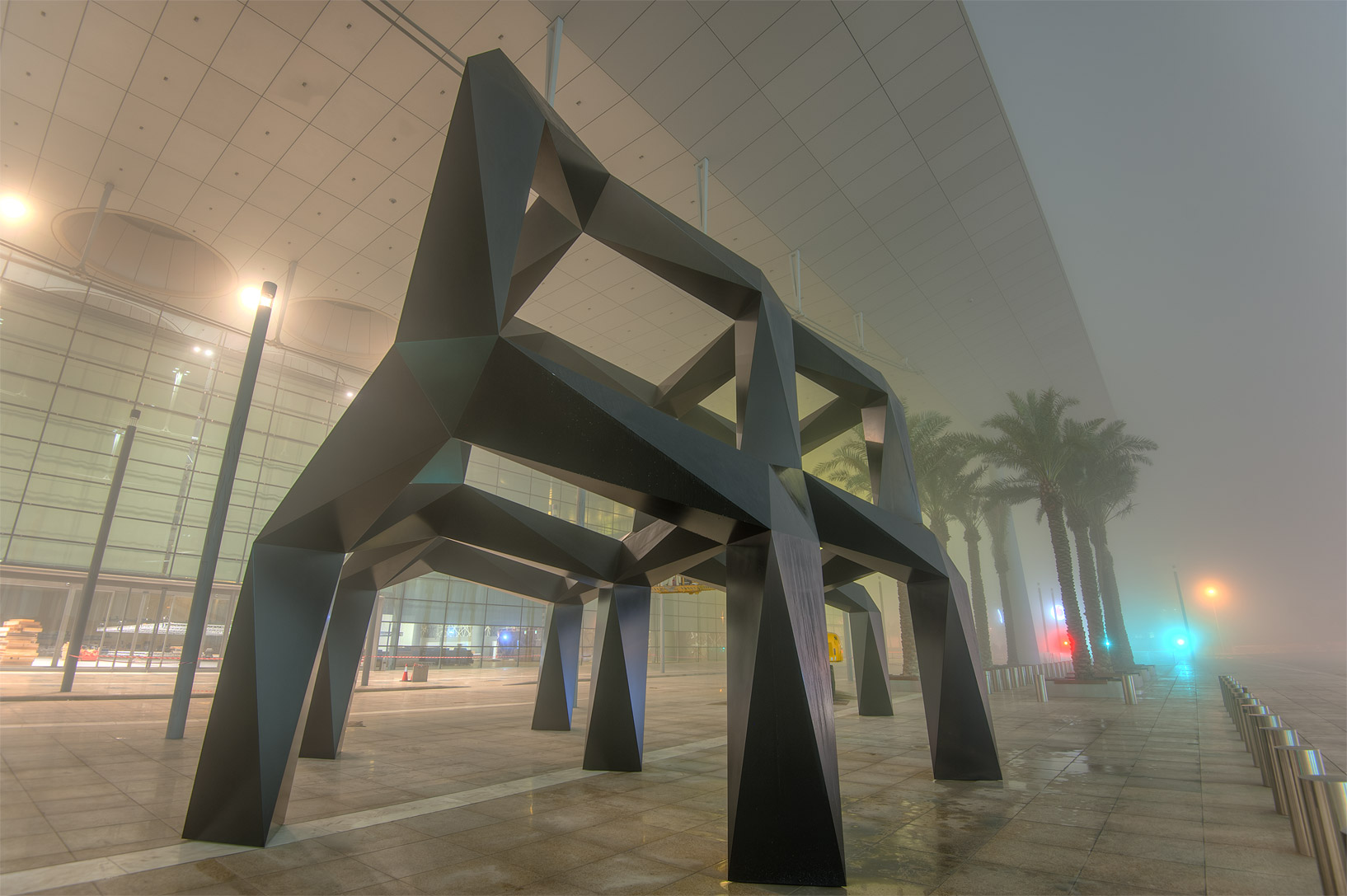 Two-tier aluminum installation Smoke by Tony...mall in West Bay in fog. Doha, Qatar