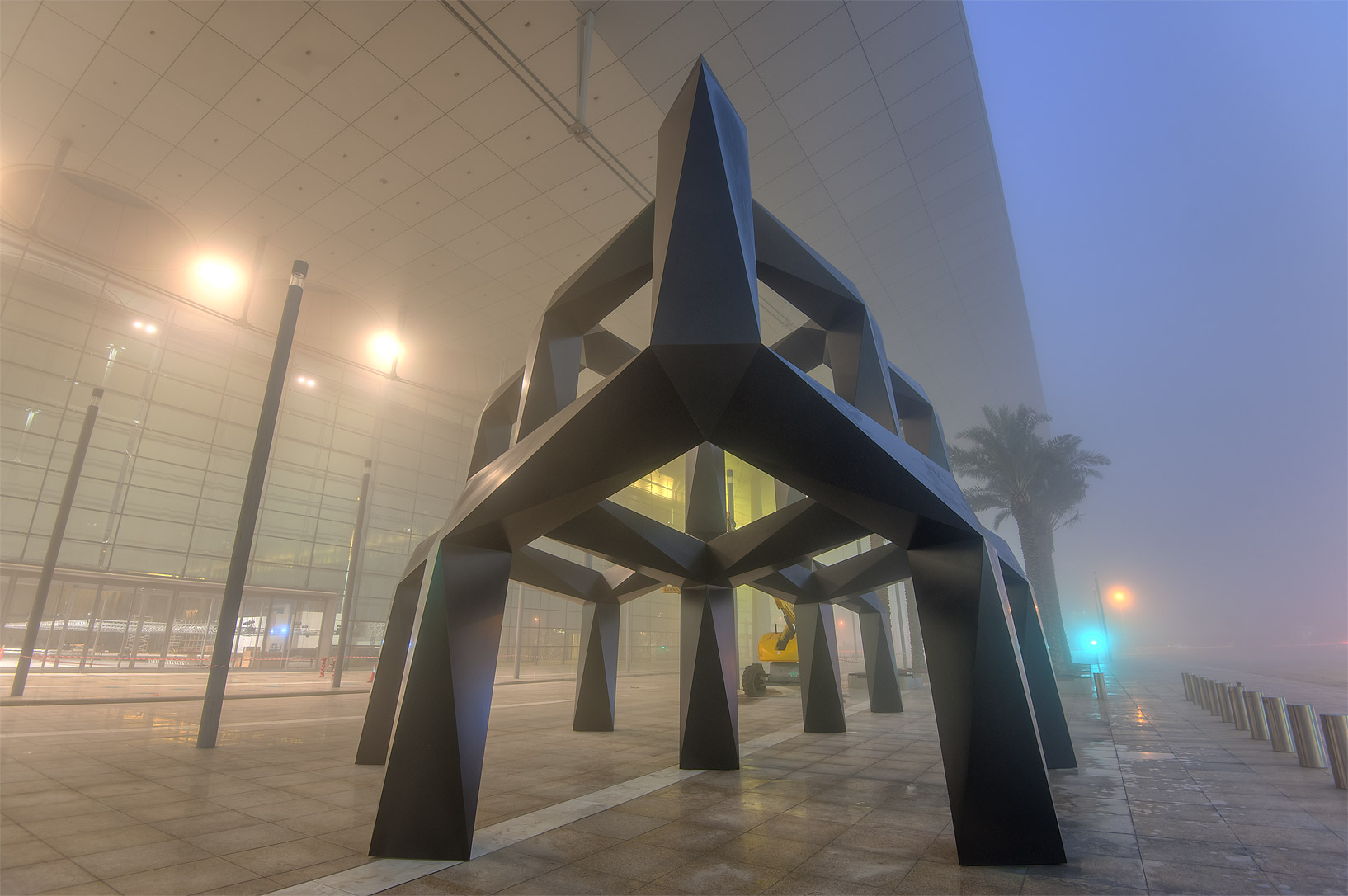 Sculpture Smoke (close-packed hexagons, like...mall in West Bay in fog. Doha, Qatar