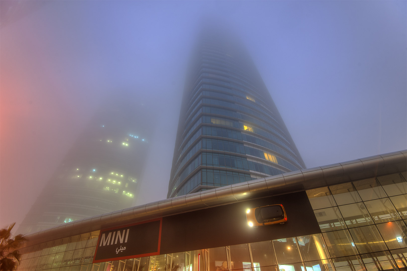 Al Fardan Twin Towers in West Bay in fog. Doha, Qatar