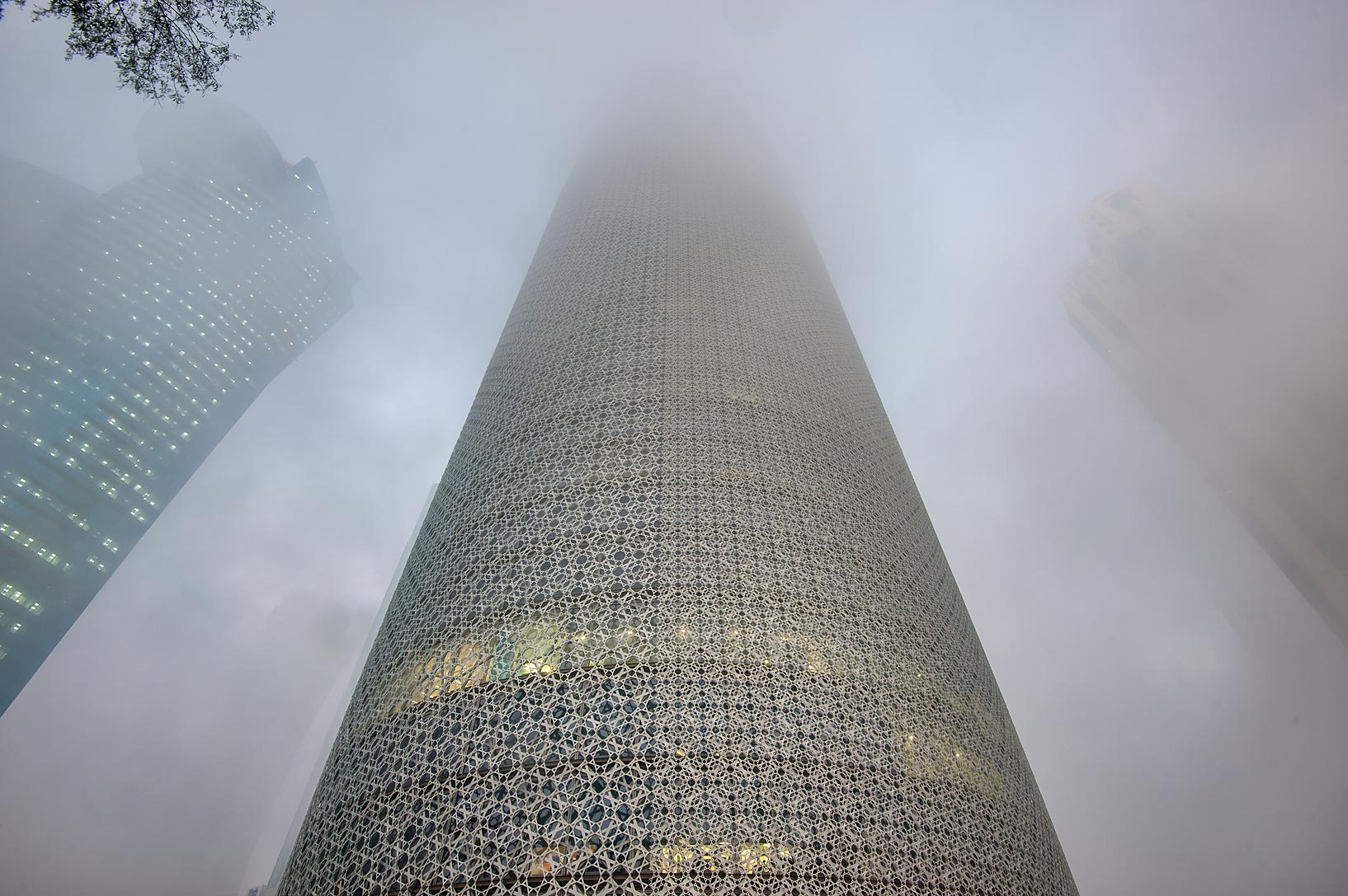 Burj Qatar Tower in West Bay in fog. Doha, Qatar