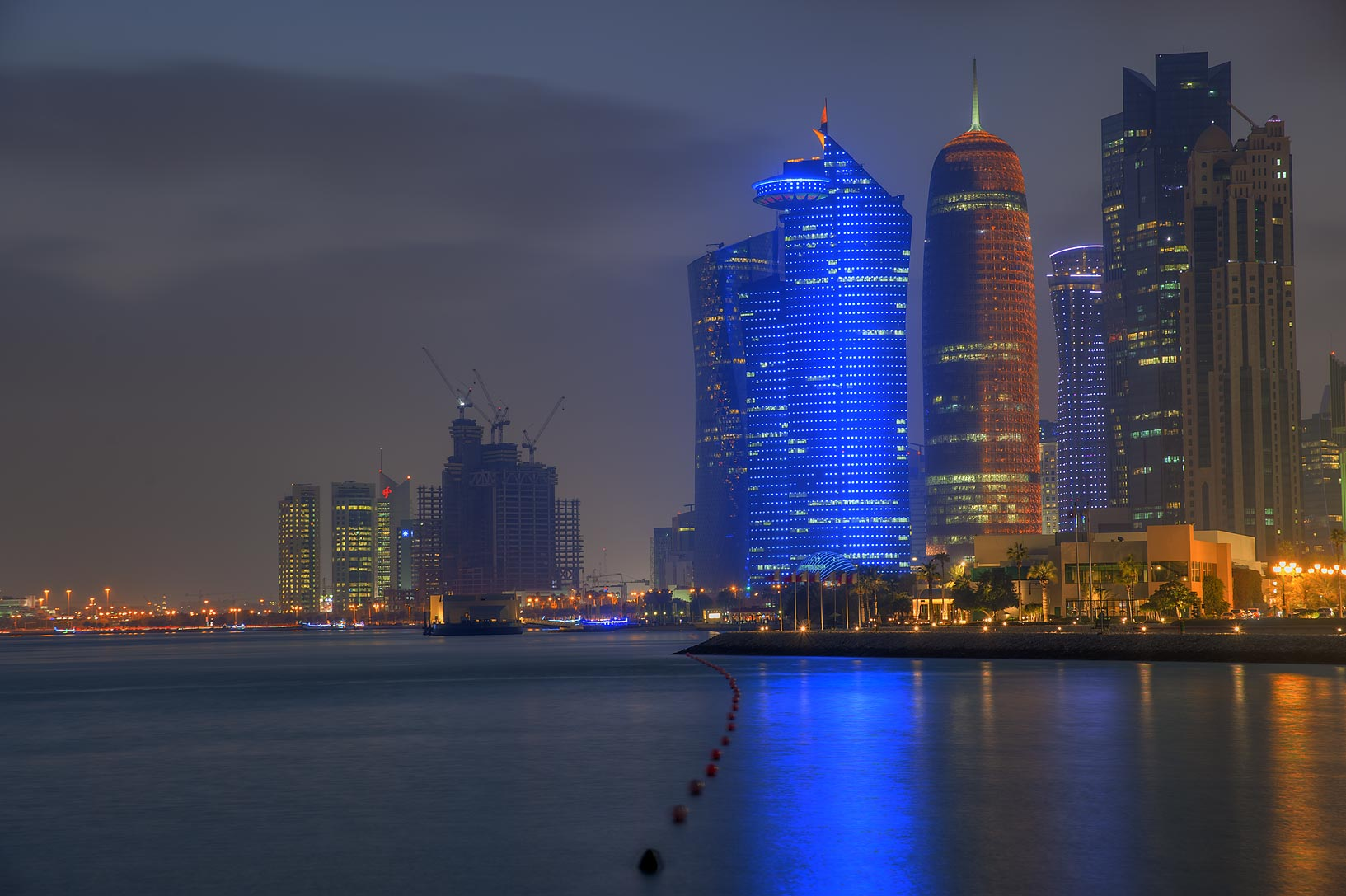 Lights of West Bay from a beach of Sheraton Hotel. Doha, Qatar