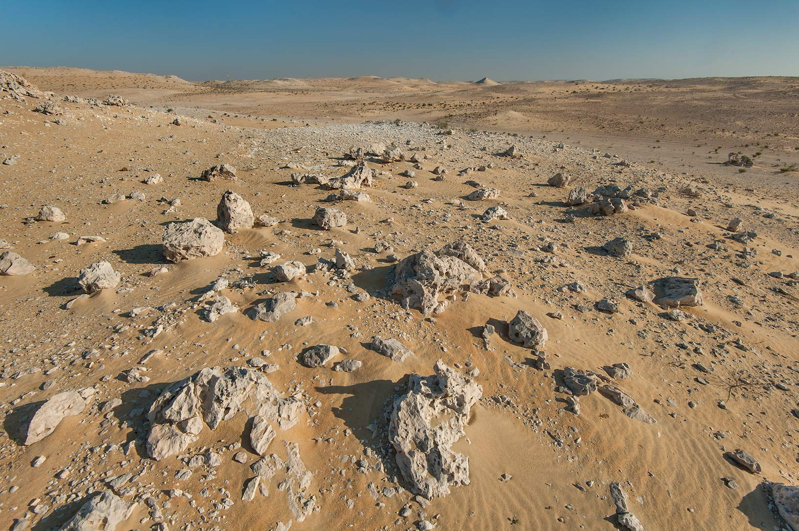 Limestone rocks in a desert on roadside of a road to Sawda Natheel. Southern Qatar