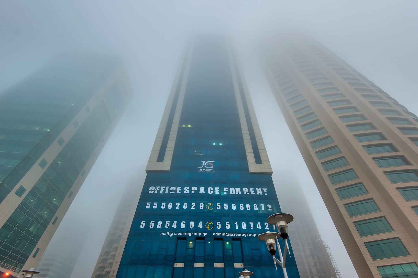 Milaha Tower in West Bay in fog. Doha, Qatar