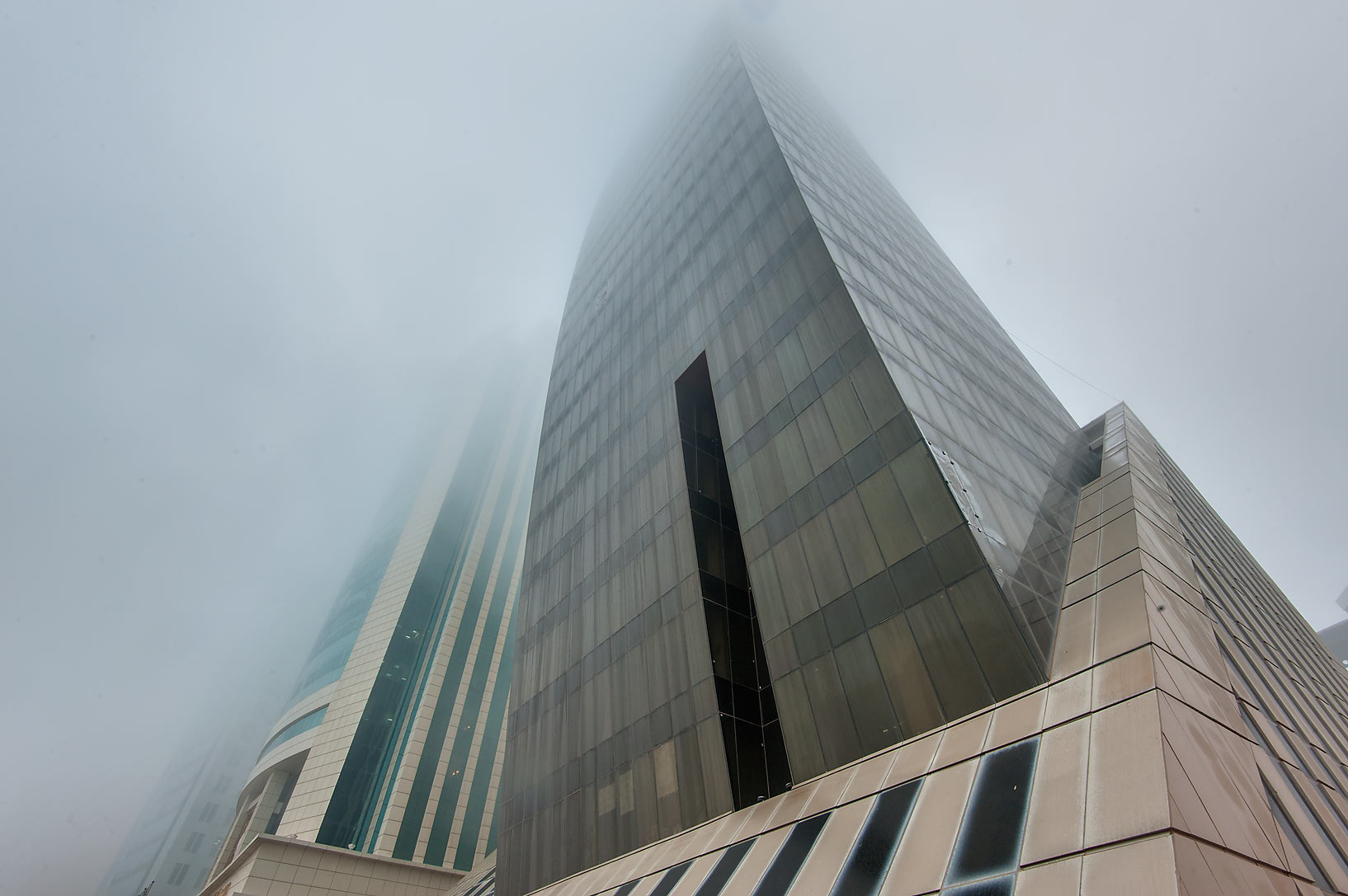 Abdulghani Commercial Tower in West Bay in fog. Doha, Qatar
