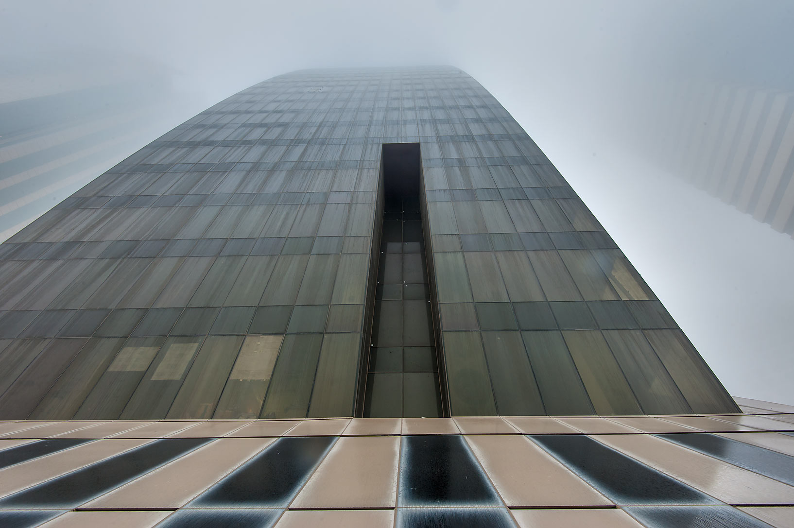 Belly of Abdulghani Commercial Tower in West Bay in fog. Doha, Qatar