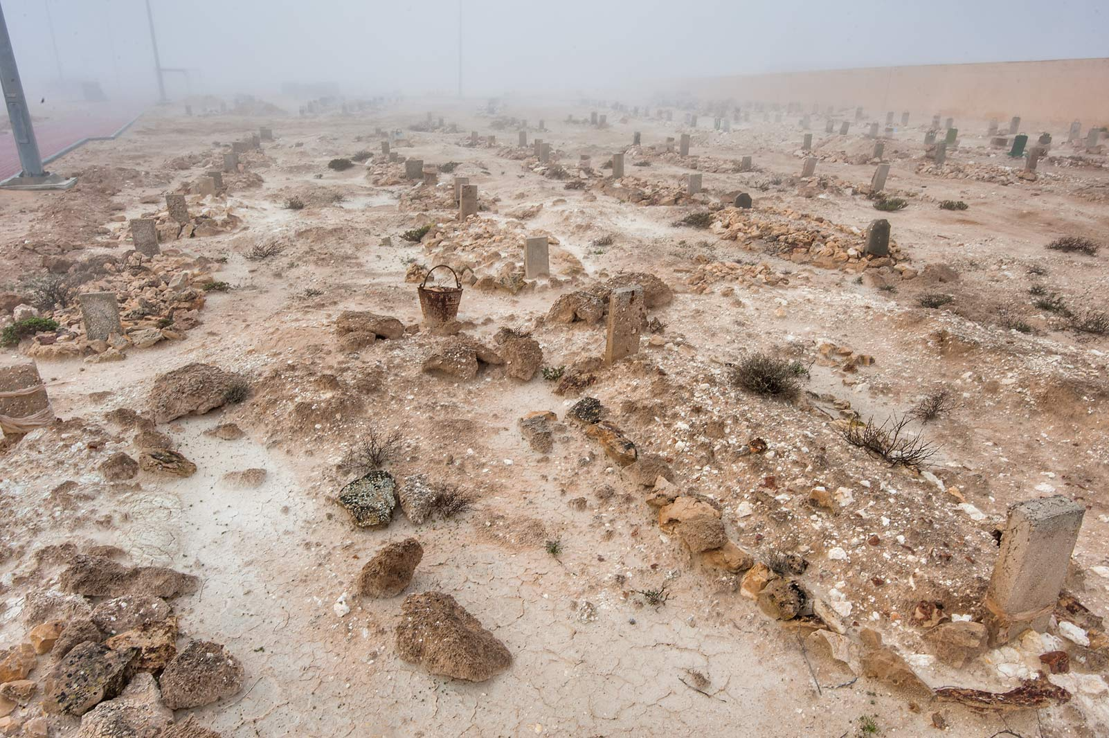 Rows of tombs in Al Khor Cemetery in fog. North from Al Khor, Qatar