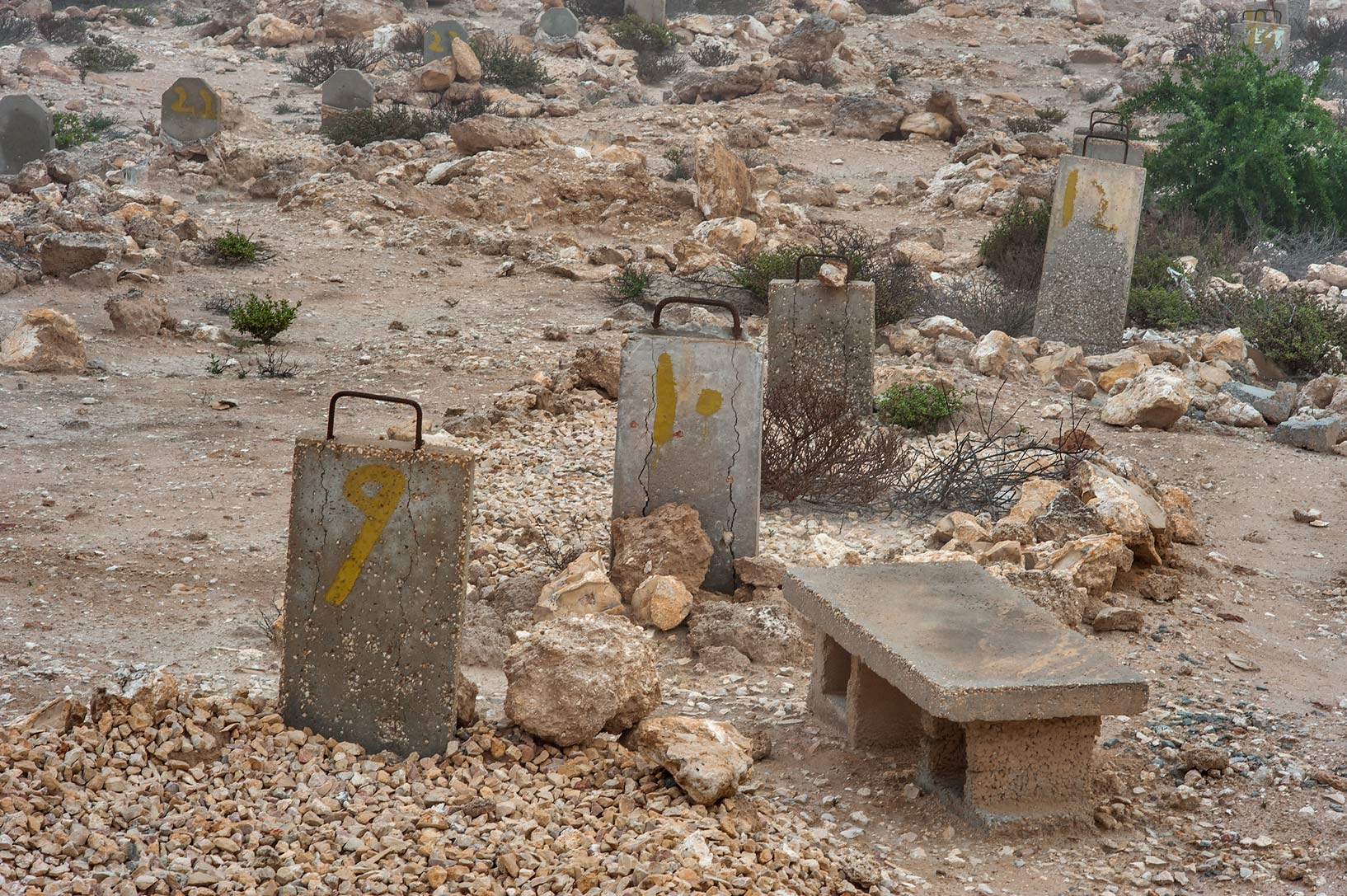 Cinderblock bench in Al Khor Cemetery. North from Al Khor, Qatar