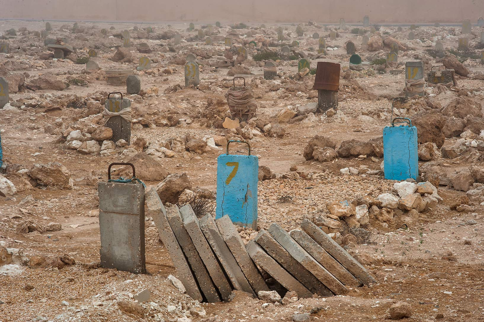 Stacked tombstones in Al Khor Cemetery. North from Al Khor, Qatar