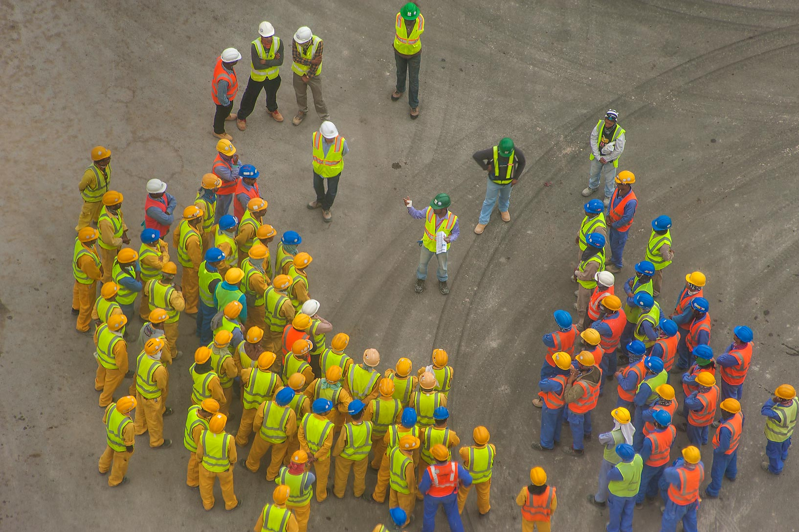 Instructing a group of workers, view from a...1-2244 of Ezdan Hotel. Doha, Qatar