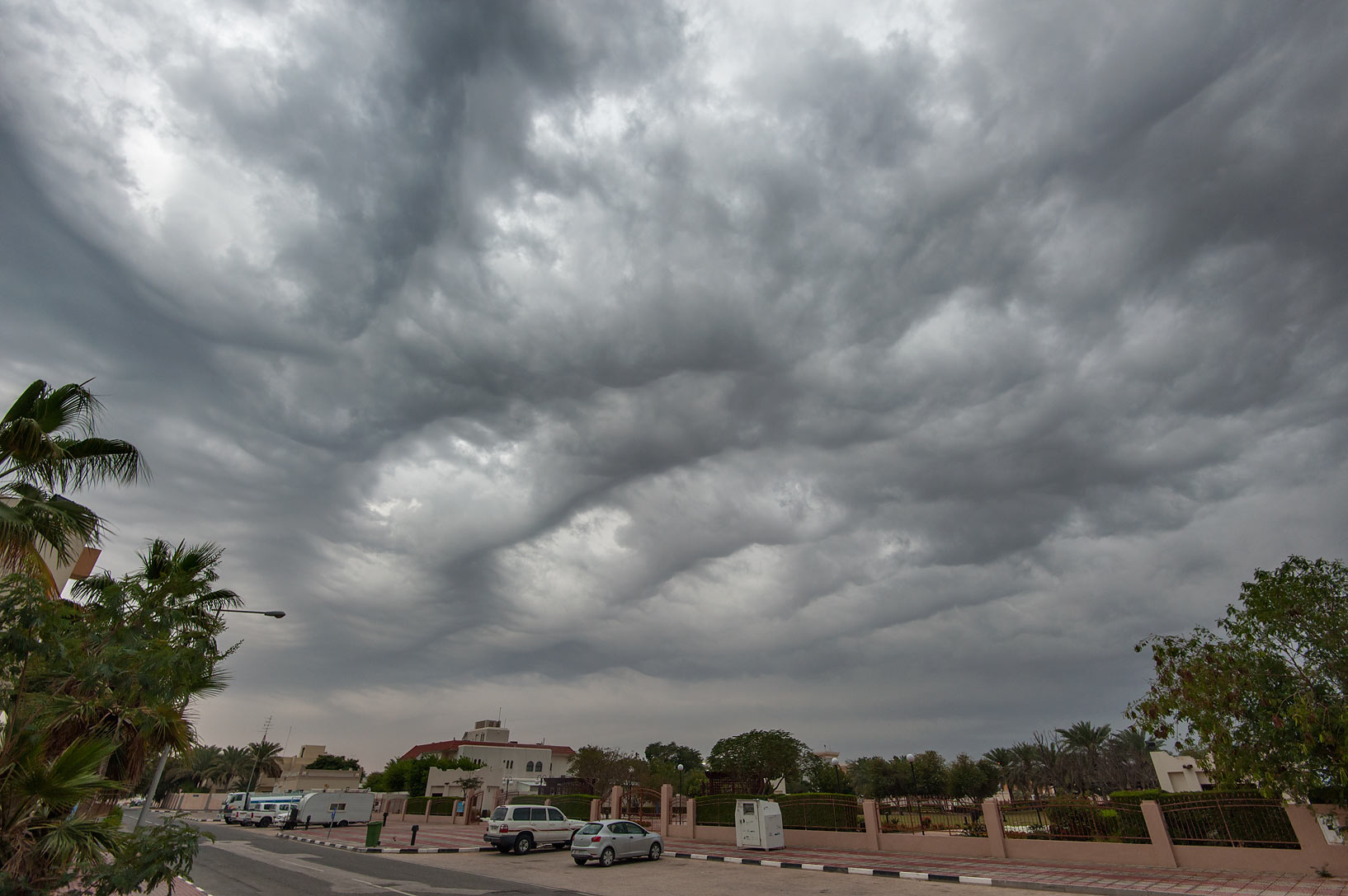 Dramatic cloudy sky on Al Rafiei St. in Onaiza area. Doha, Qatar