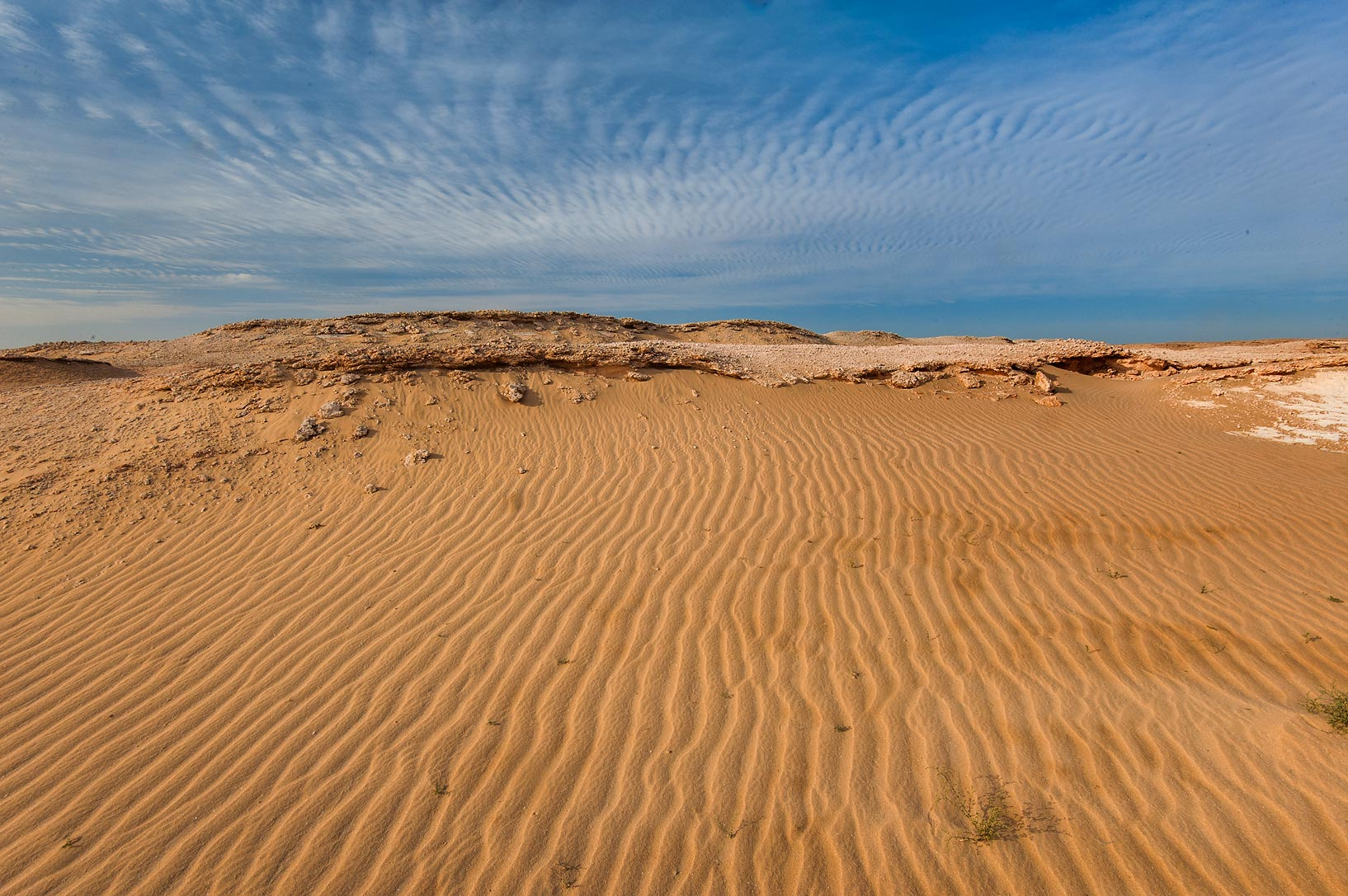 Sand and cloud ripples in area of Jebel Al-Nakhsh (Khashm an Nakhsh). South-western Qatar