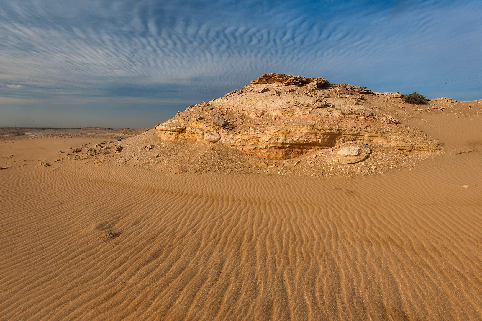 Sand and sky ripples in area of Jebel Al-Nakhsh (Khashm an Nakhsh). South-western Qatar