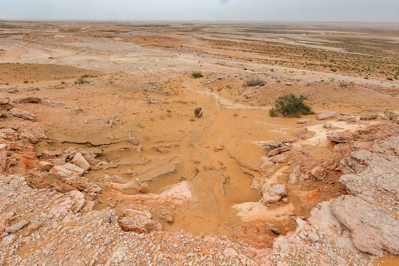 Washed out edge of the plateau of a tabletop hill...Reserve near Abu Samra. Southern Qatar