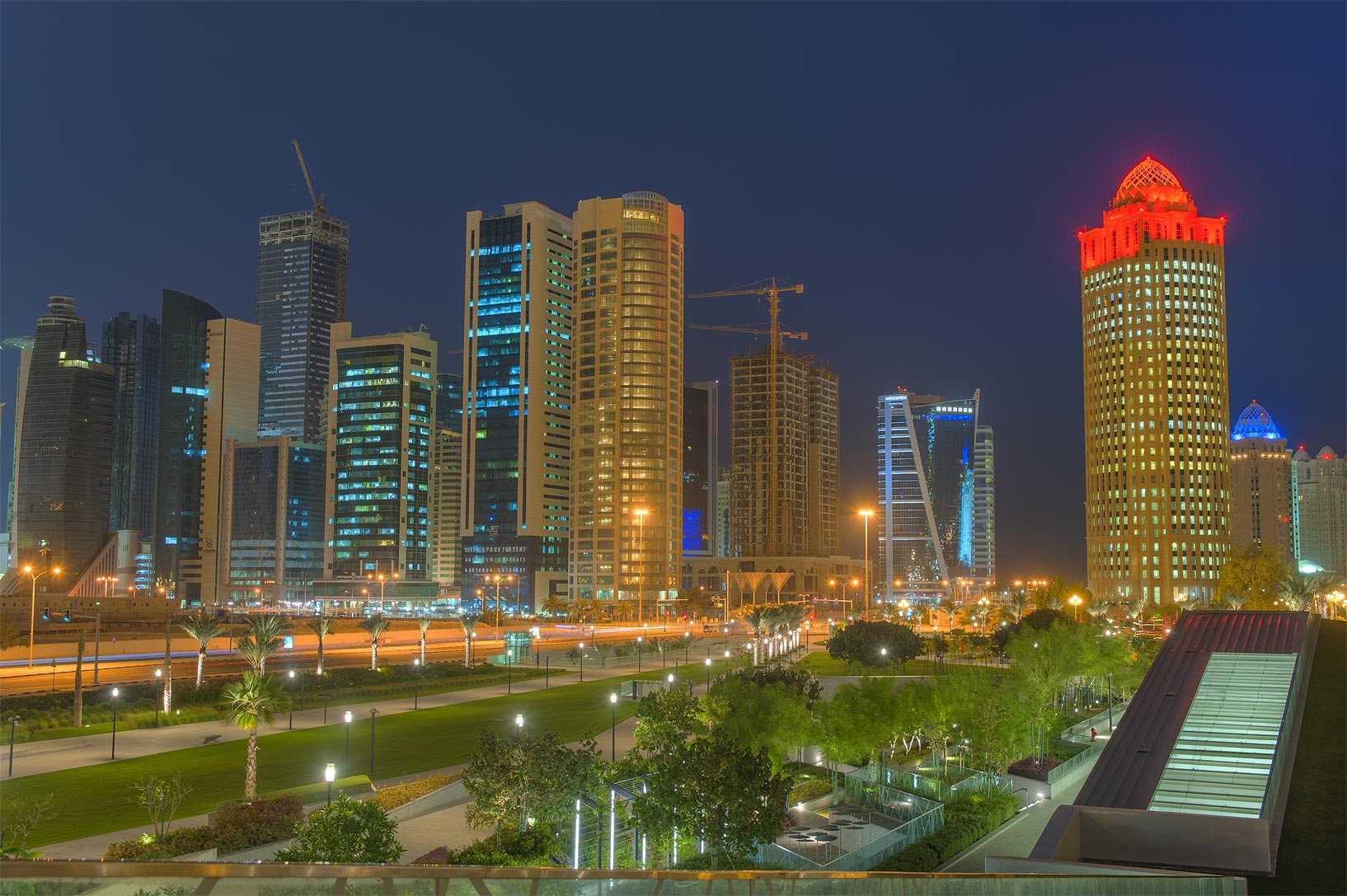 New park and West Bay from a grassy hill below Sheraton Hotel. Doha, Qatar