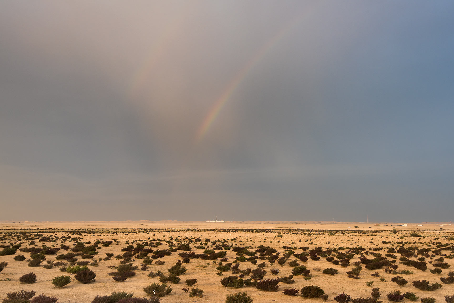 Rainbow over a flat area east from Dukhan. Qatar