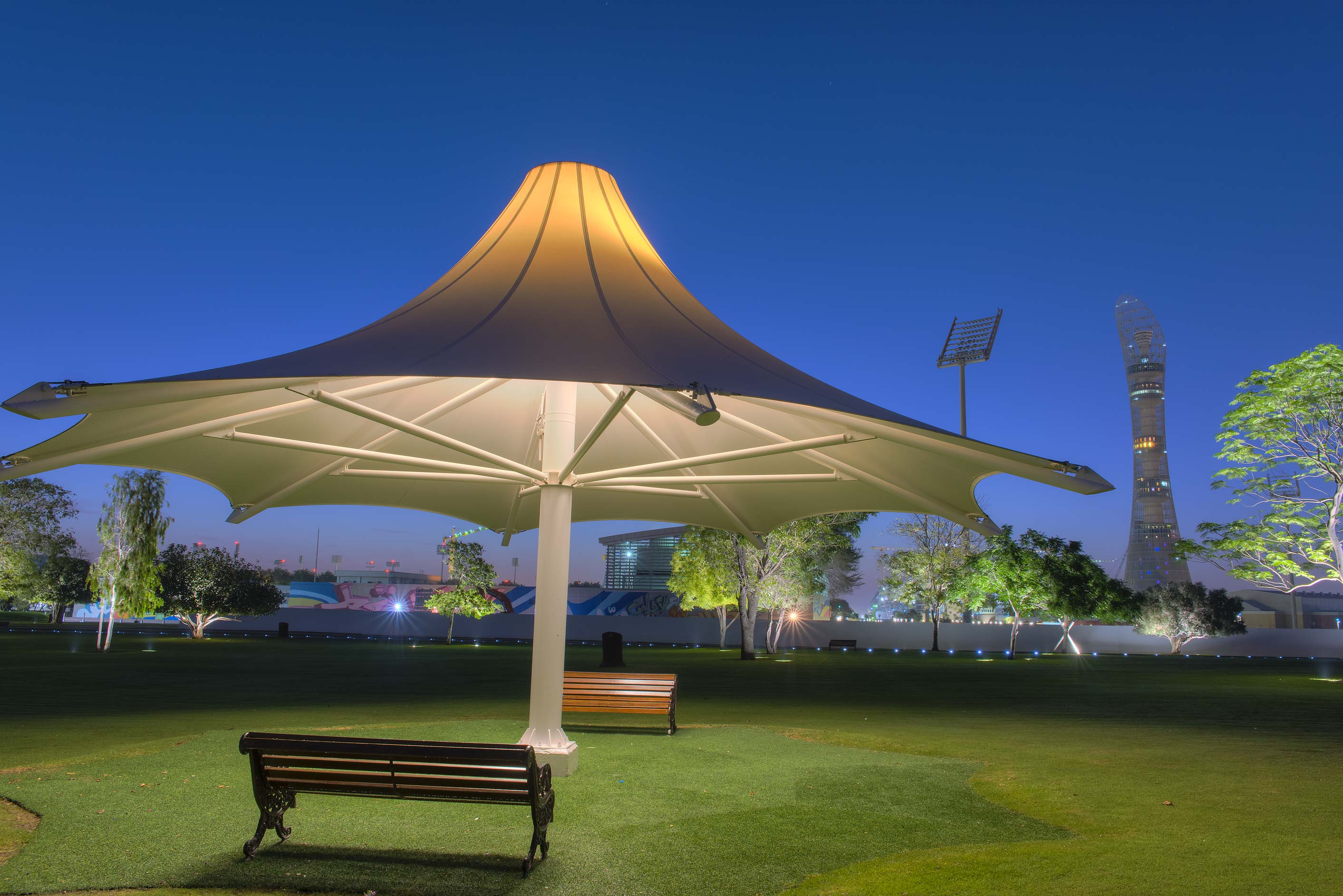Umbrella shade at early morning in Aspire Park. Doha, Qatar
