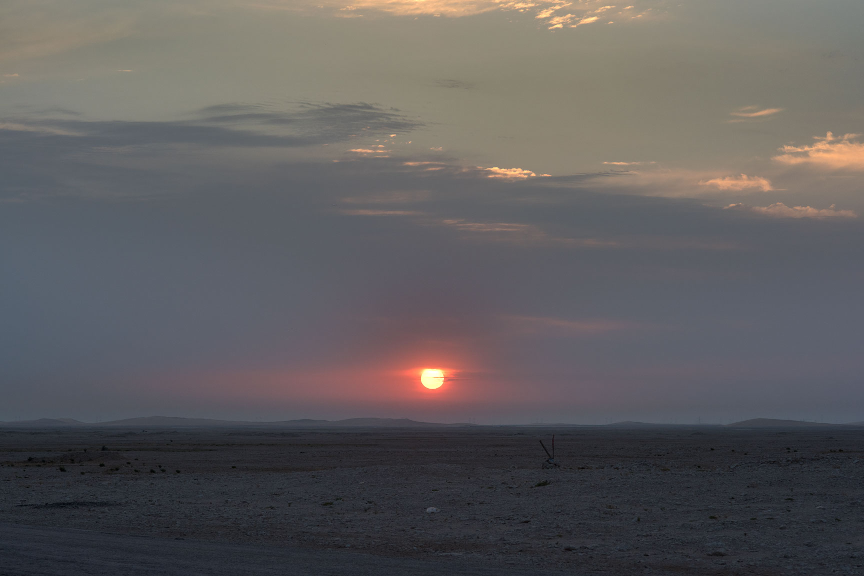 Sunrise from a road to Harrarah (Al Kharrarah). Southern Qatar