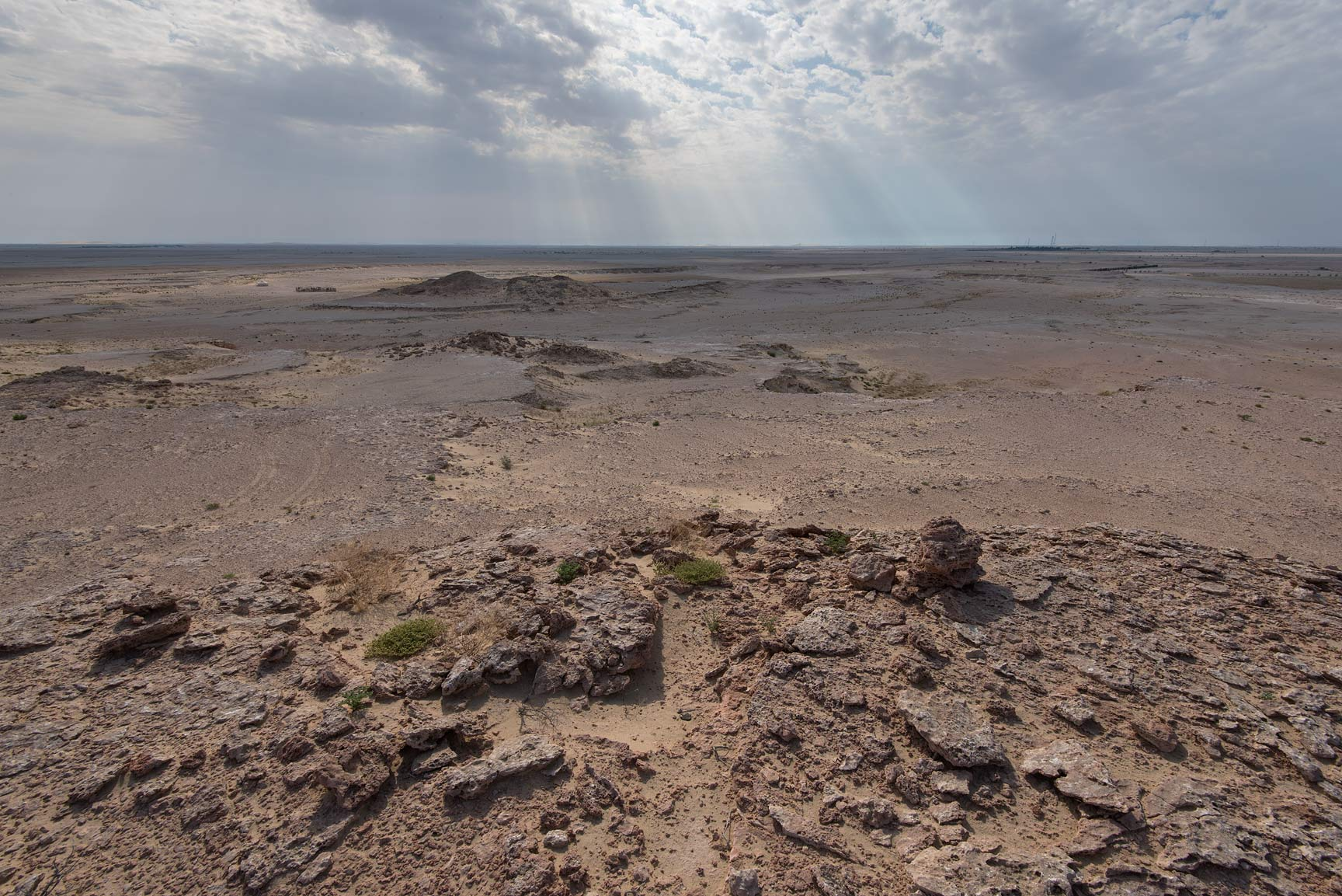 View of desert from limestone cliffs in Harrarah (Al Kharrarah). Southern Qatar