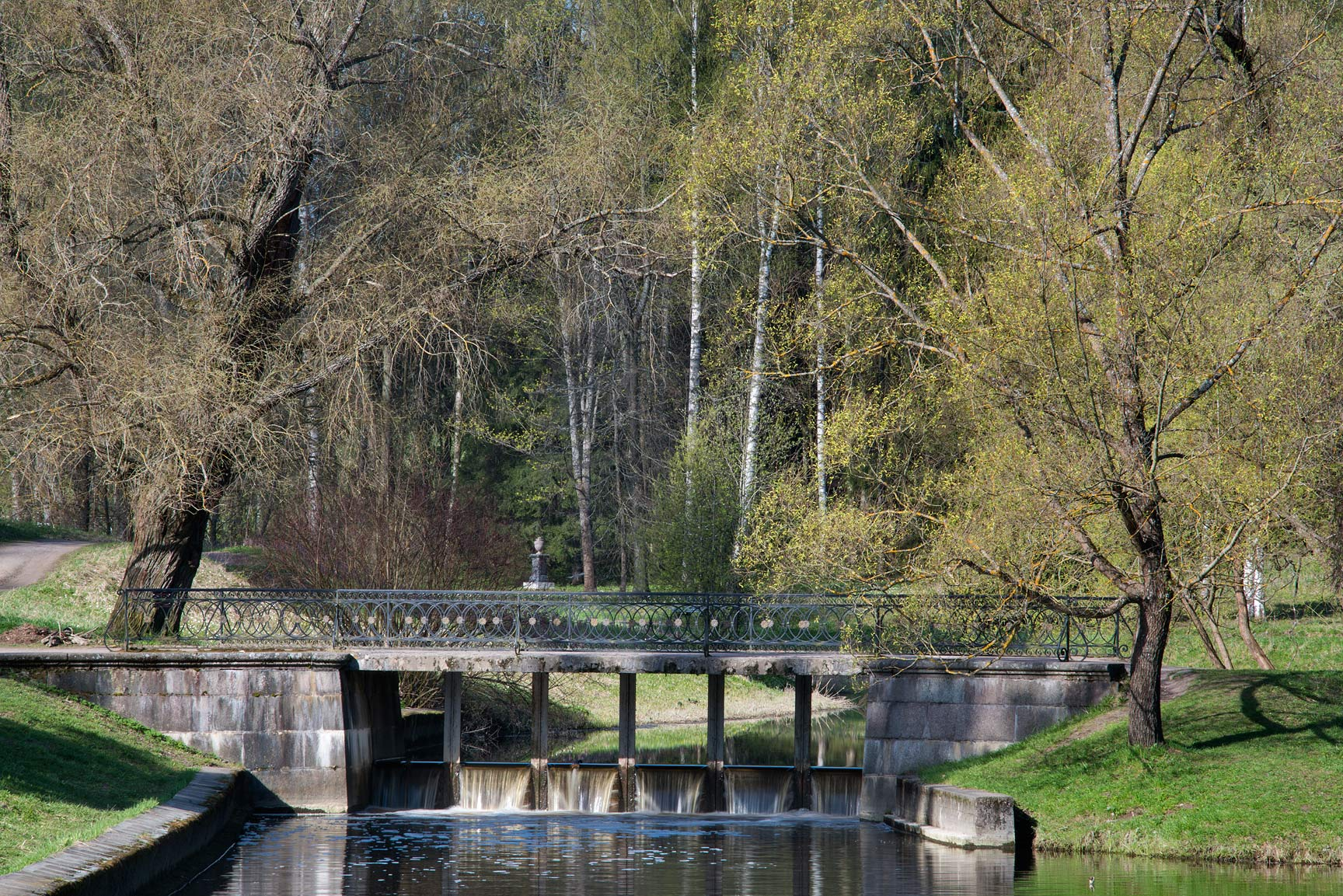 Black Bridge with a dam in Pavlovsk Park. Pavlovsk, suburb of St.Petersburg, Russia