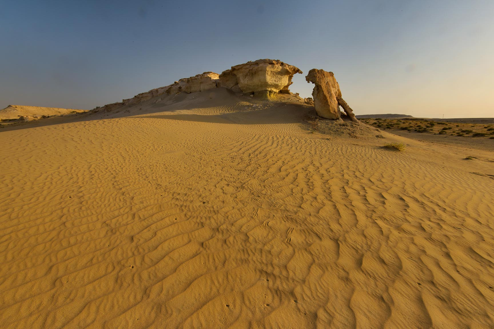 Windblown sand and limestone cliffs in Maszhabiya...Reserve near Abu Samra. Southern Qatar