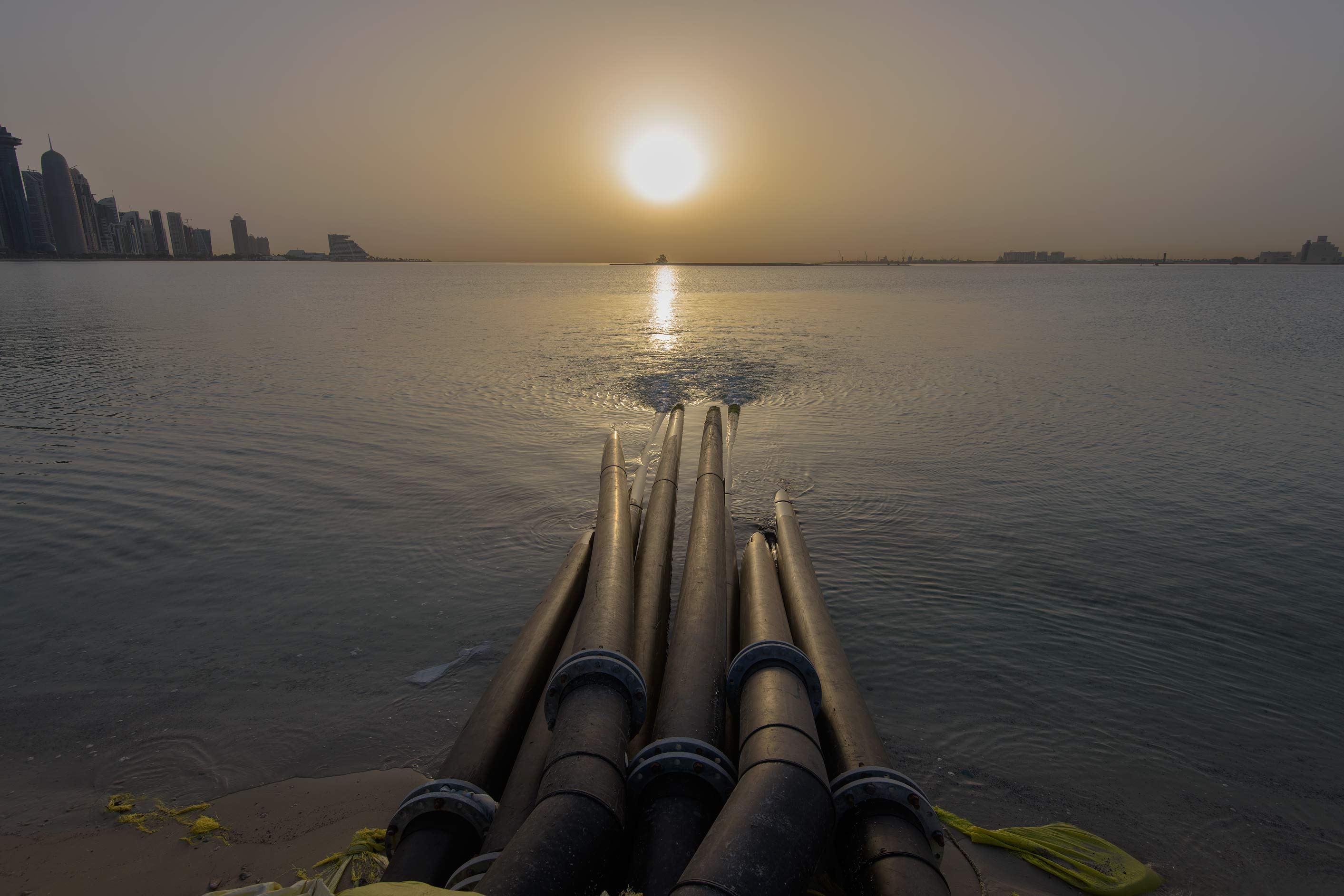 Sewage disposal pipes on Corniche at sunrise. Doha, Qatar