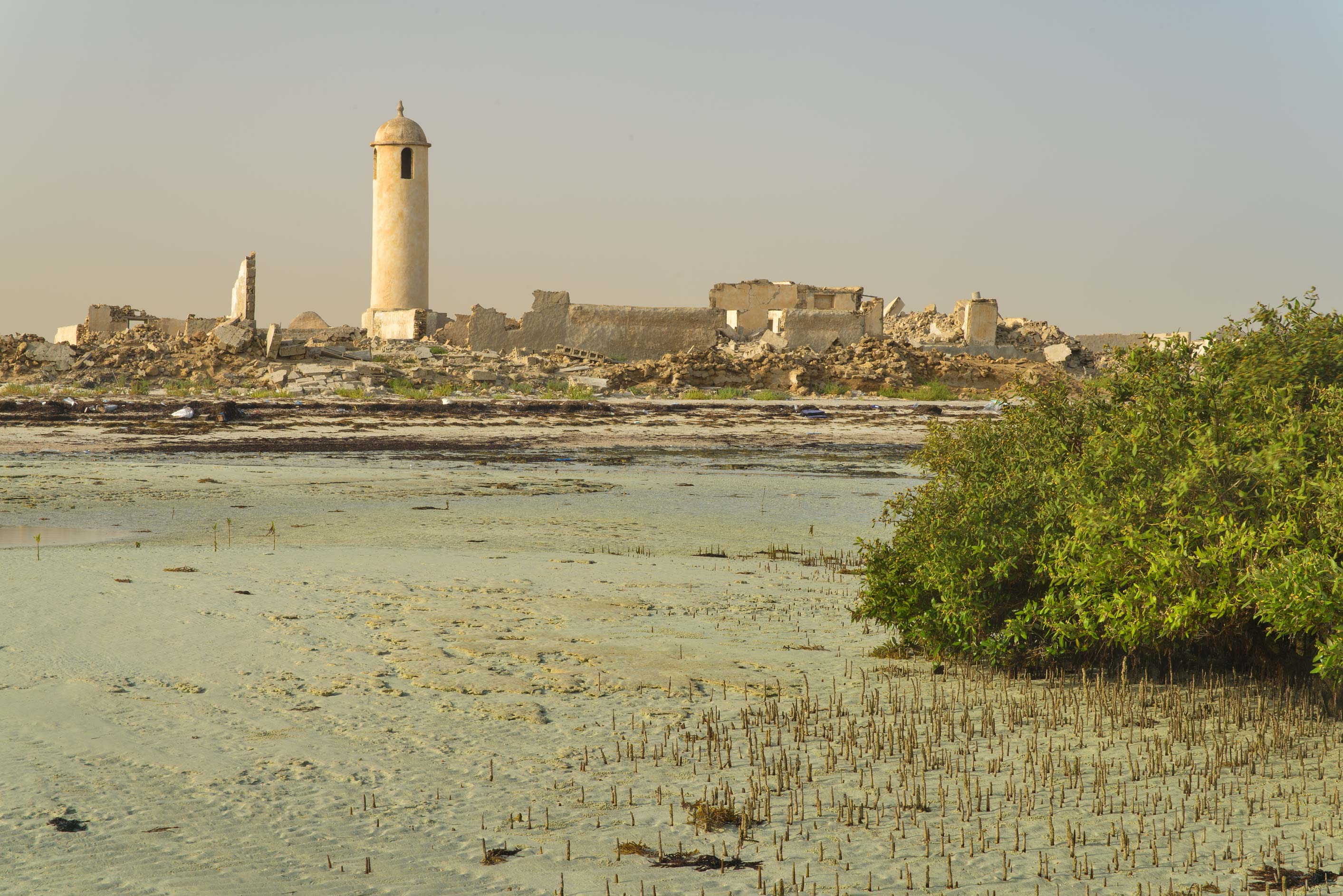 Minaret of a mosque in Al Areesh (Arish), view from a beach. Northern Qatar