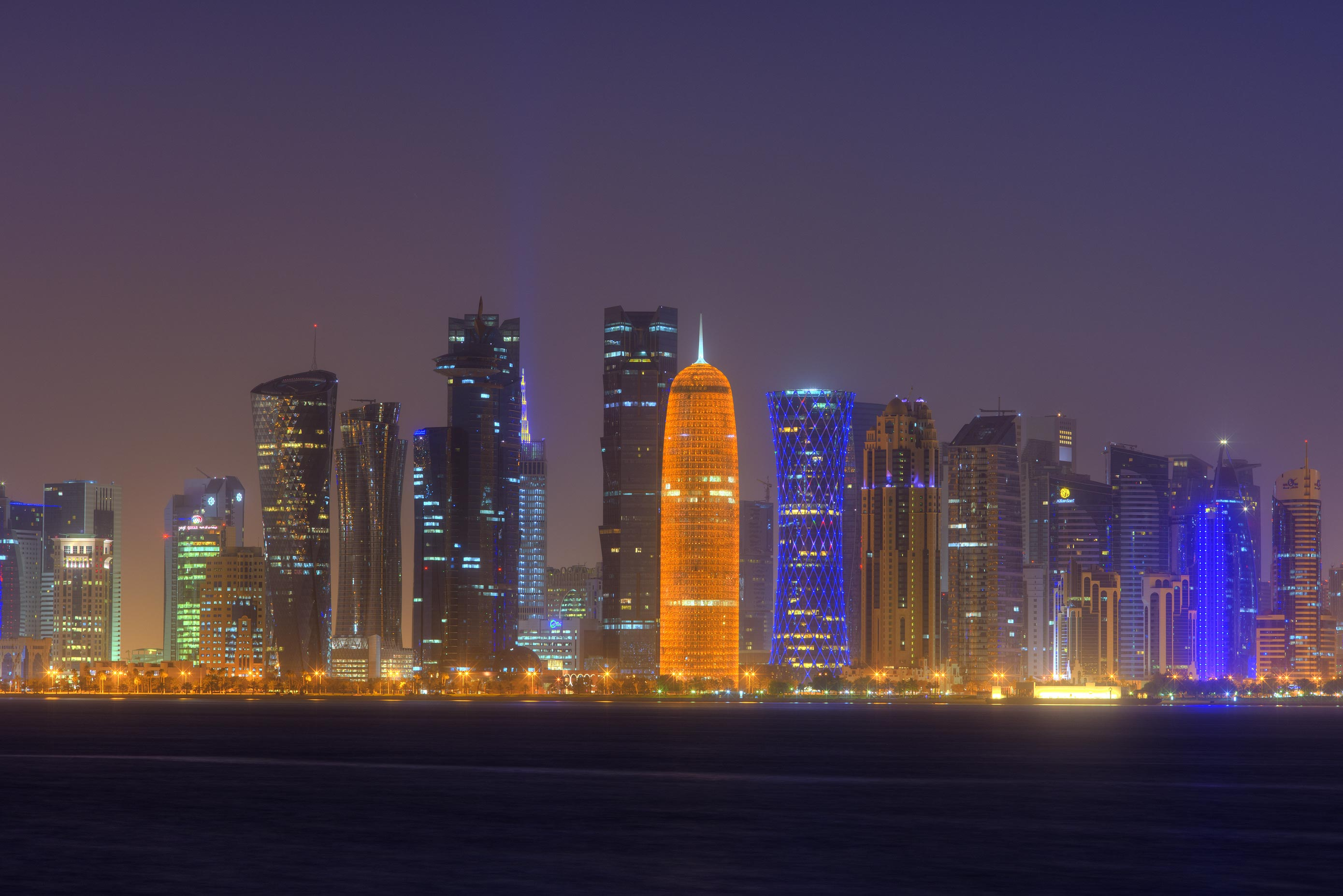 View of West Bay from Museum of Islamic Art. Doha, Qatar Park pier in dusk. Doha, Qatar