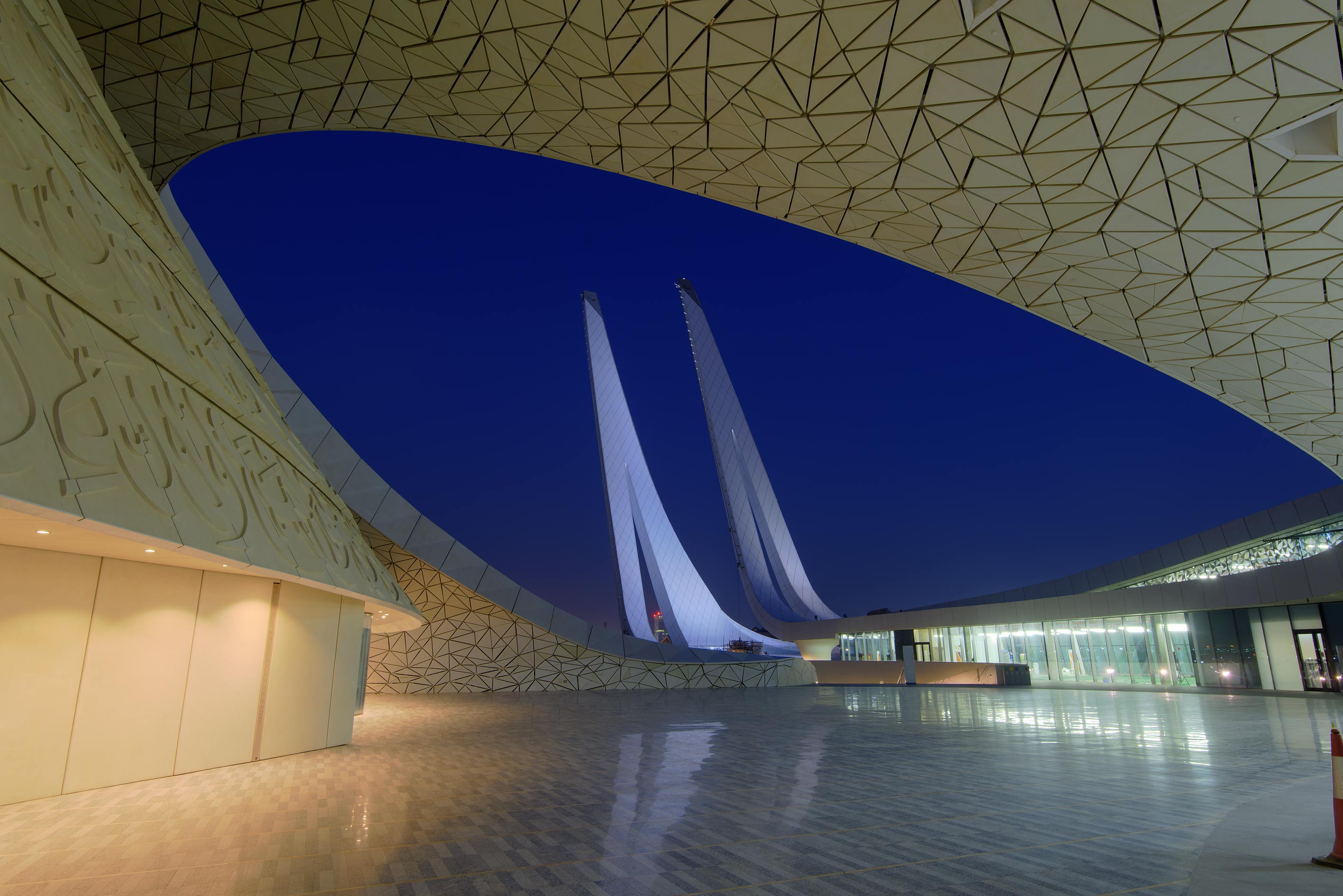 Entrance of first floor courtyard of Education City Mosque in dusk. Doha, Qatar