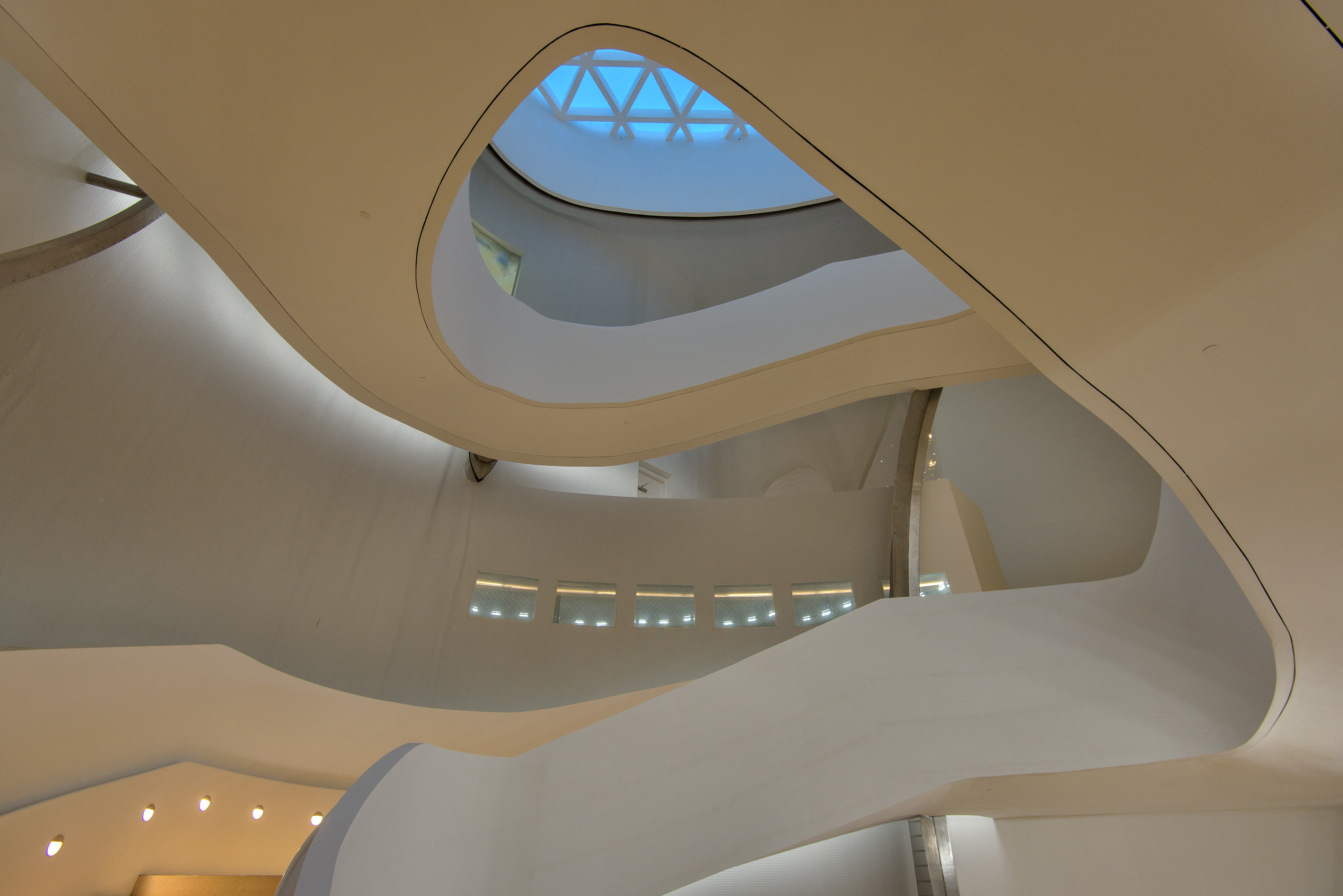 Looking up from a fancy curved staircase inside Education City Mosque. Doha, Qatar