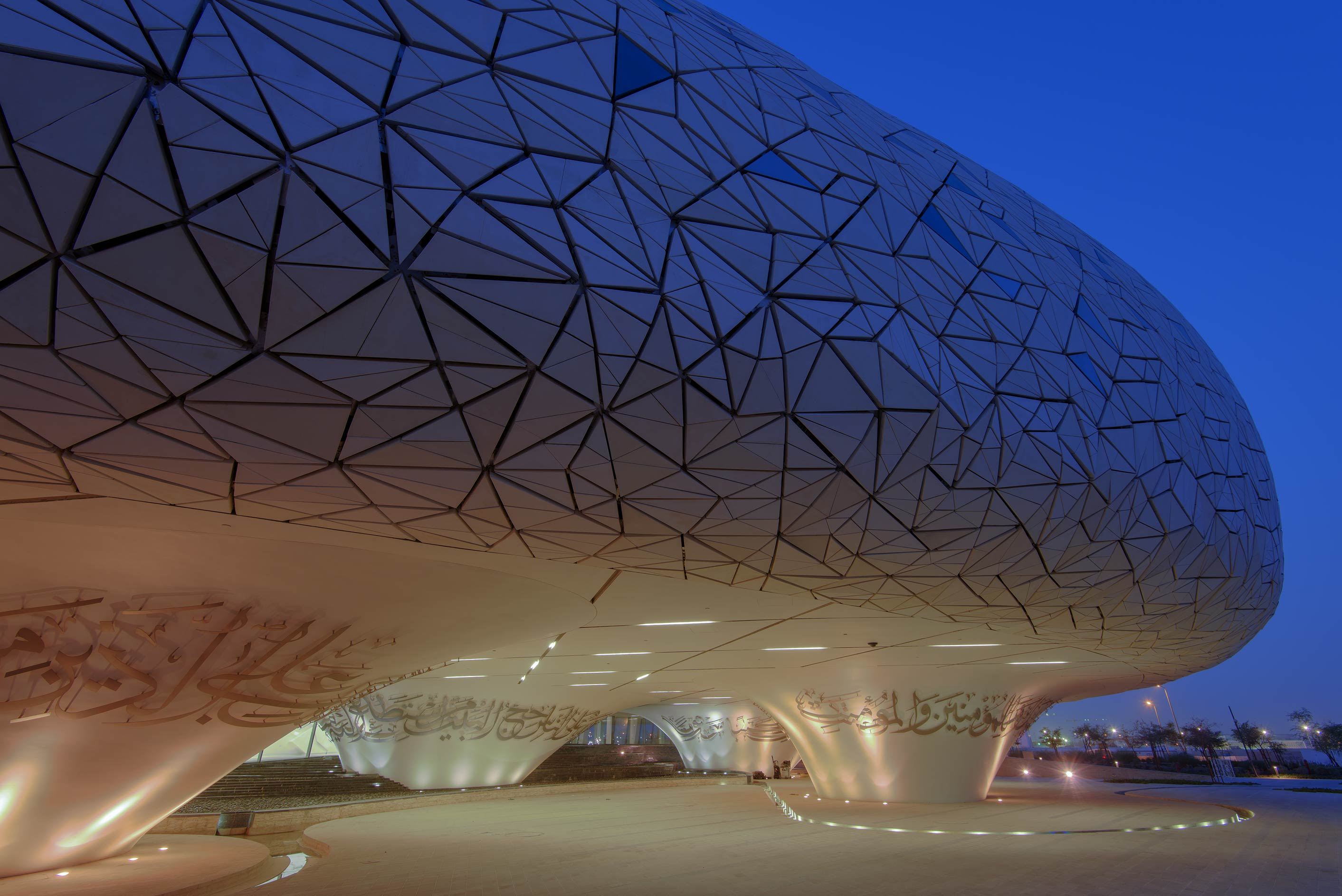 Rounded building with geometric patterns of...from the ground floor. Doha, Qatar
