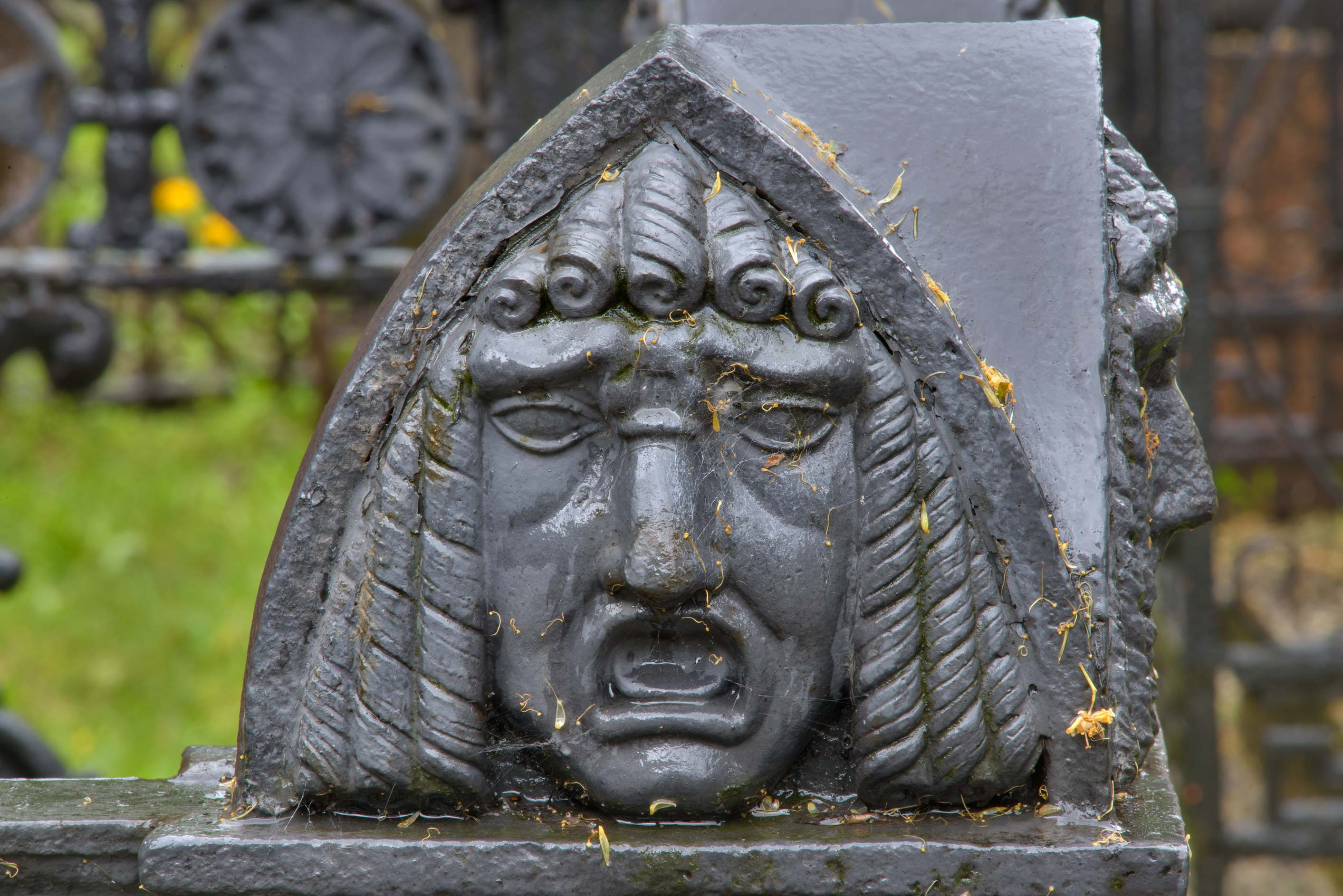 Angry face on a tomb in Necropolis of Alexander...Cemetery). St.Petersburg, Russia