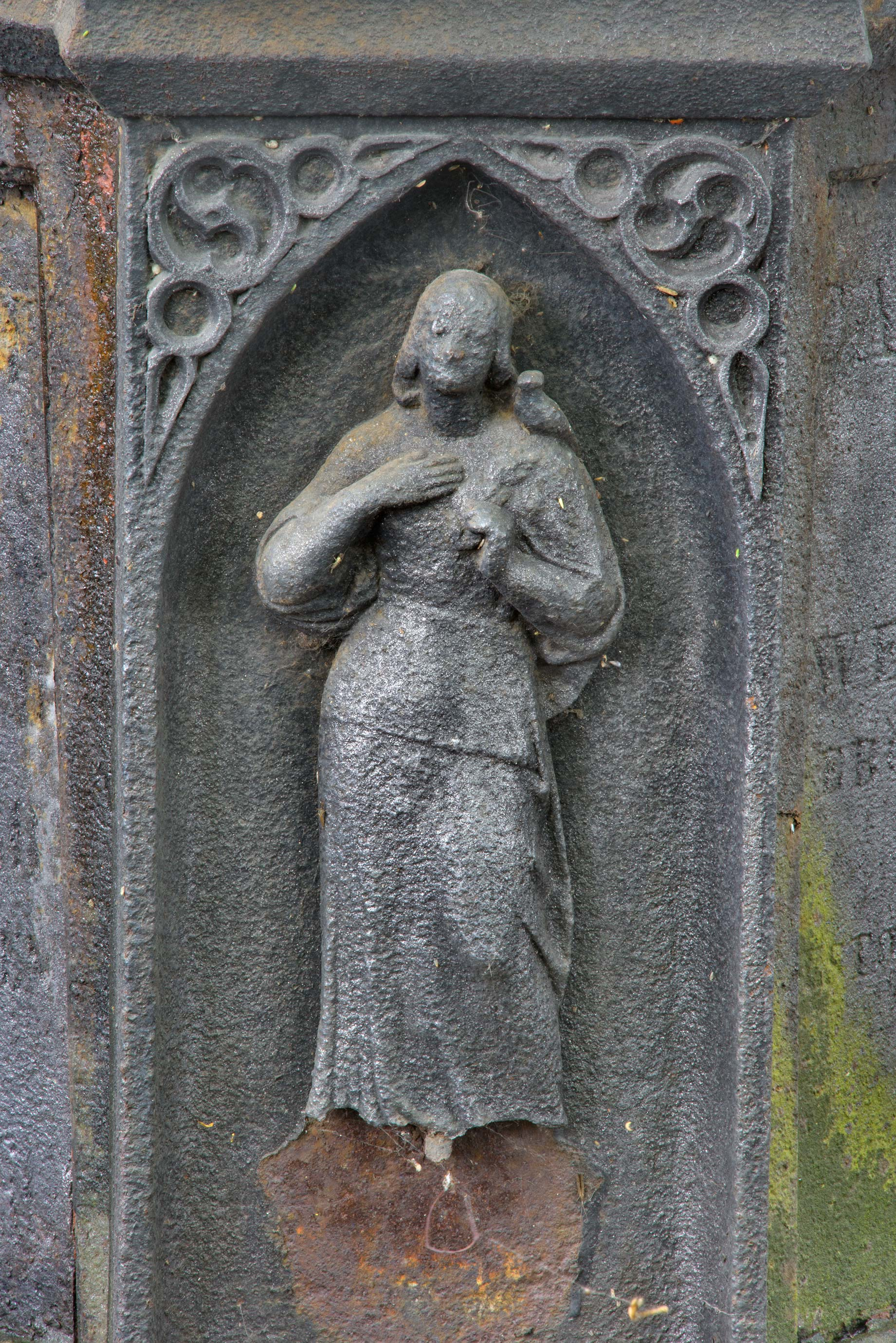 Levitating iron figure on a tomb in Necropolis of...Cemetery). St.Petersburg, Russia