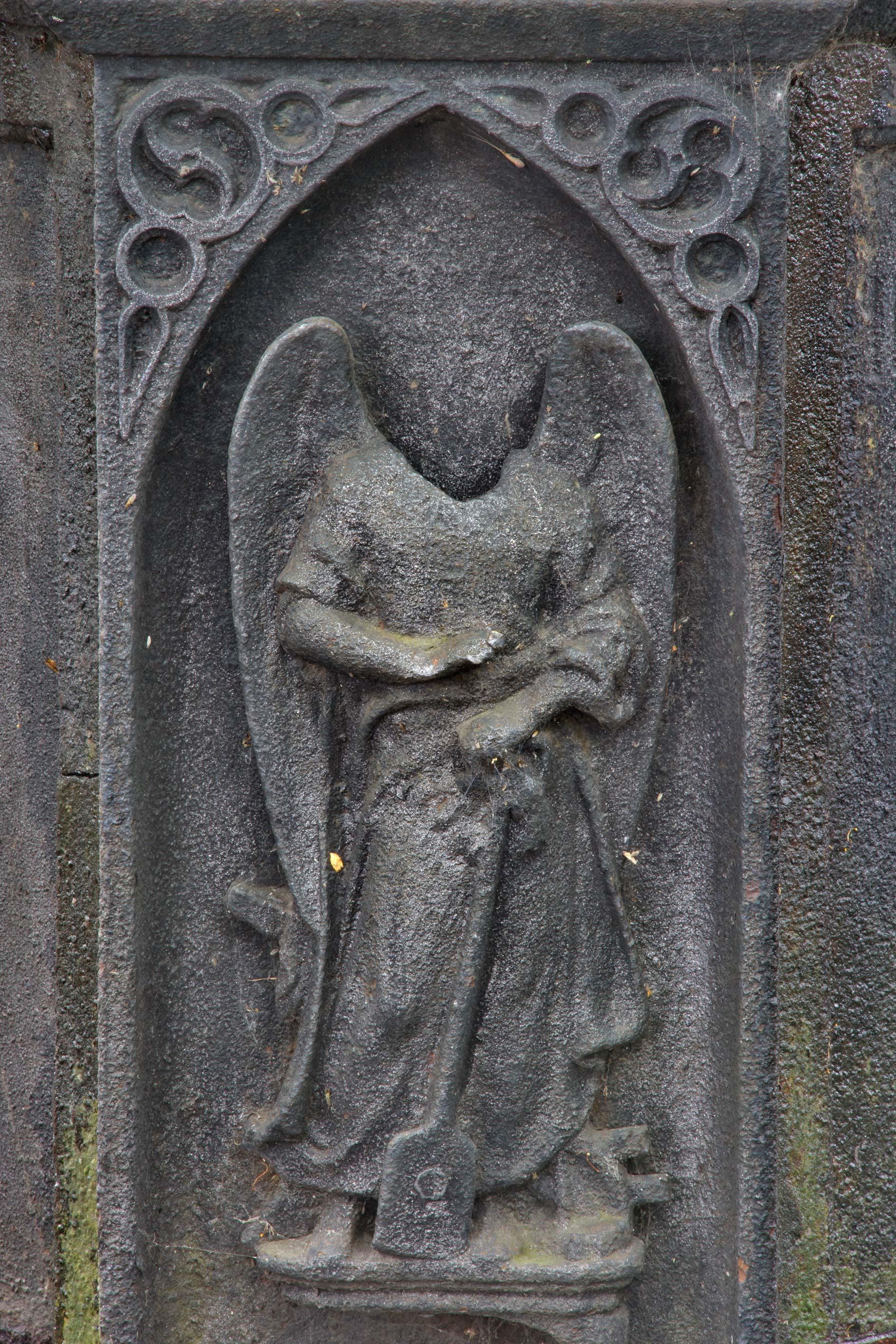 Headless iron angel on a tomb in Necropolis of...Cemetery). St.Petersburg, Russia