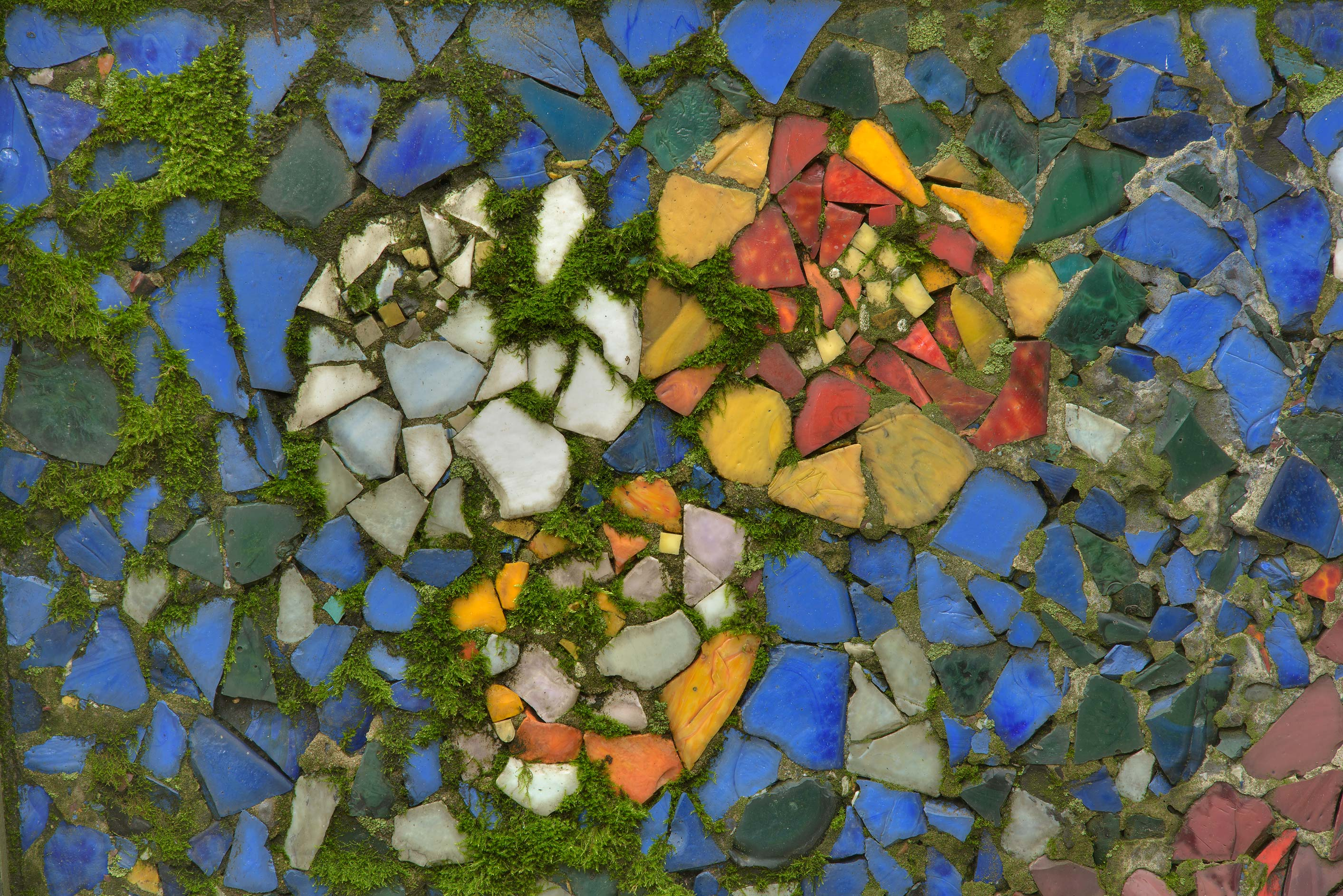 Colored glass mosaic on a tombstone in...Cemetery. St.Petersburg, Russia