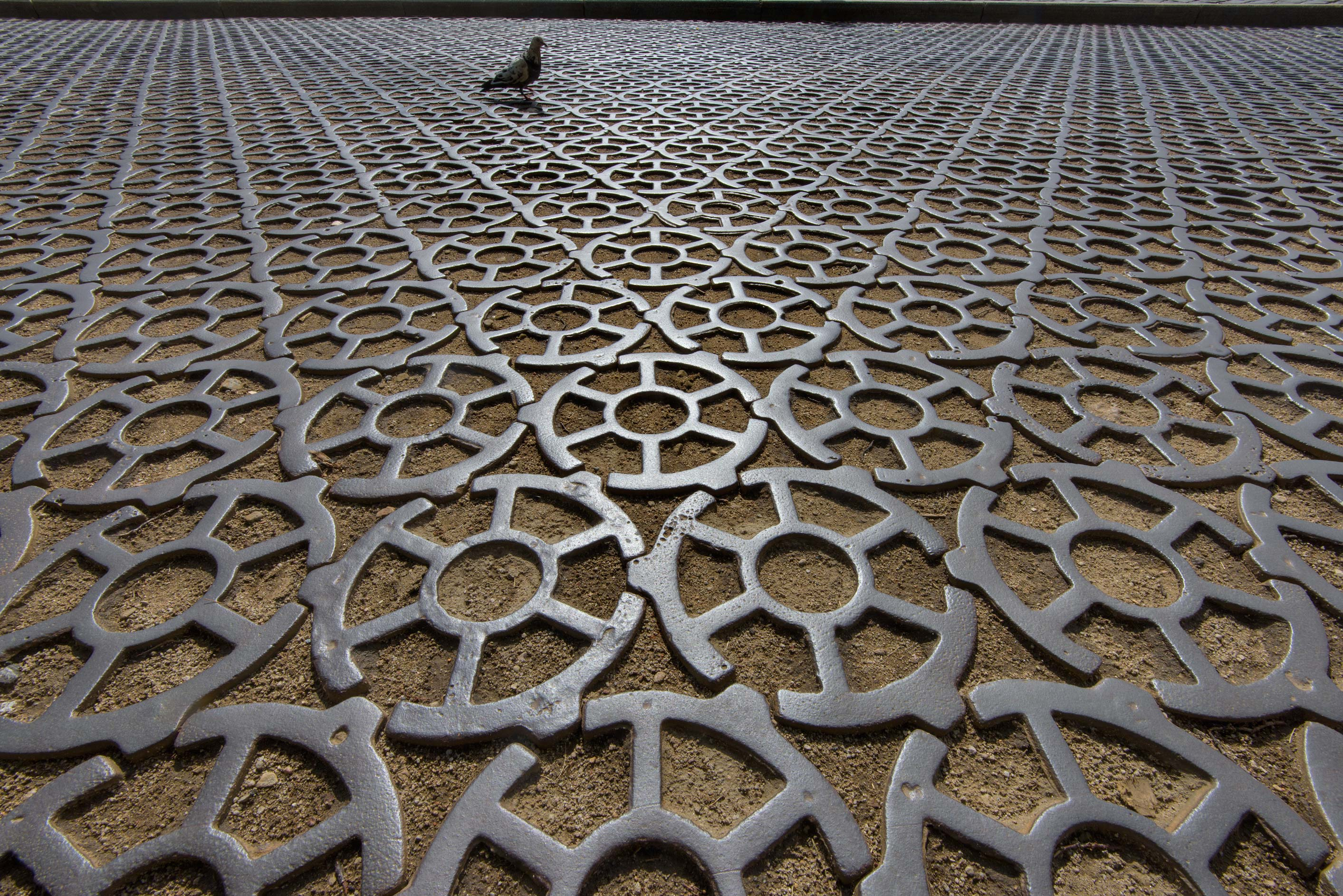Road paved by iron circles in Kronstadt. St.Petersburg, Russia