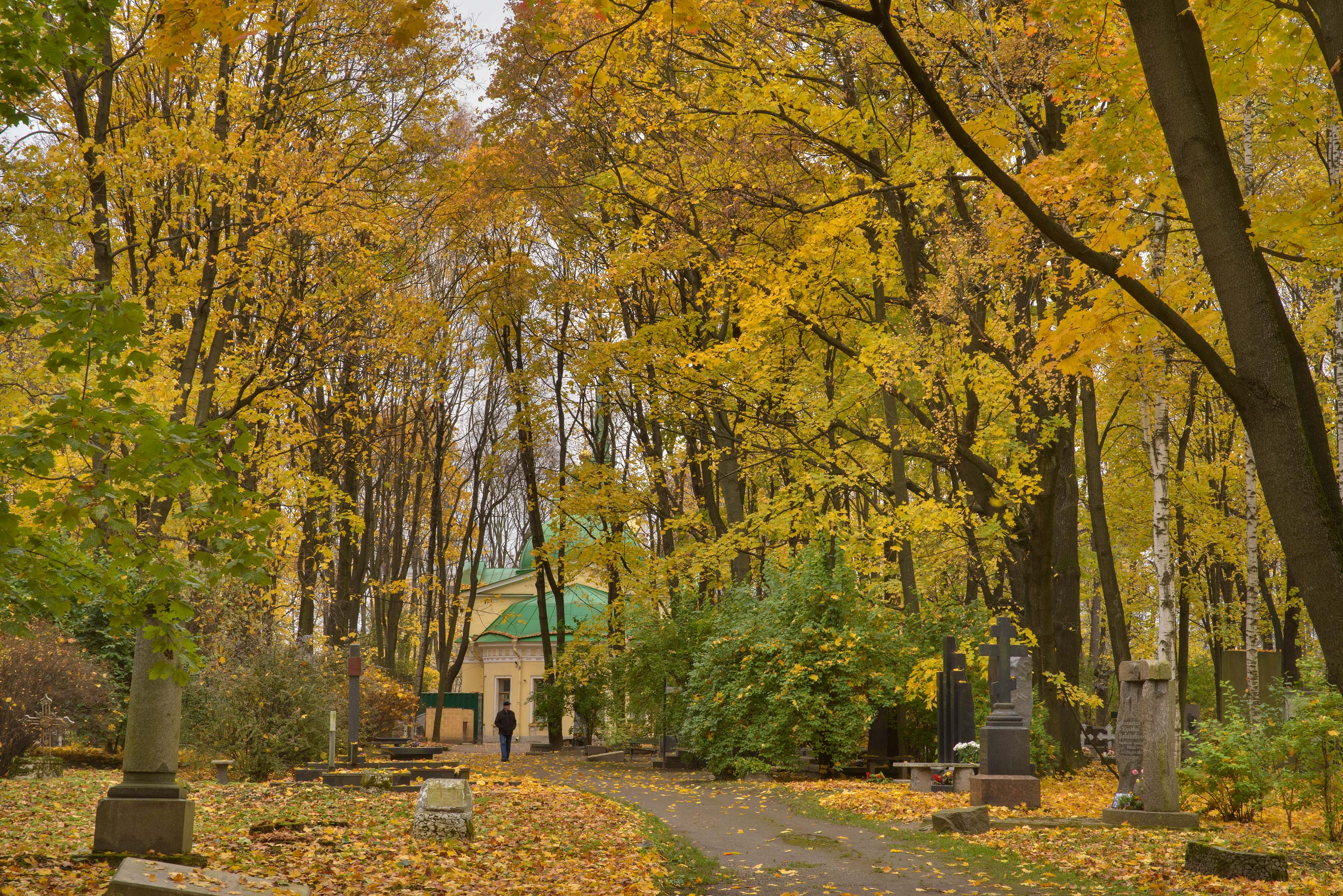 Fall colors of Architecture Lane in Literatorskie...Cemetery. St.Petersburg, Russia