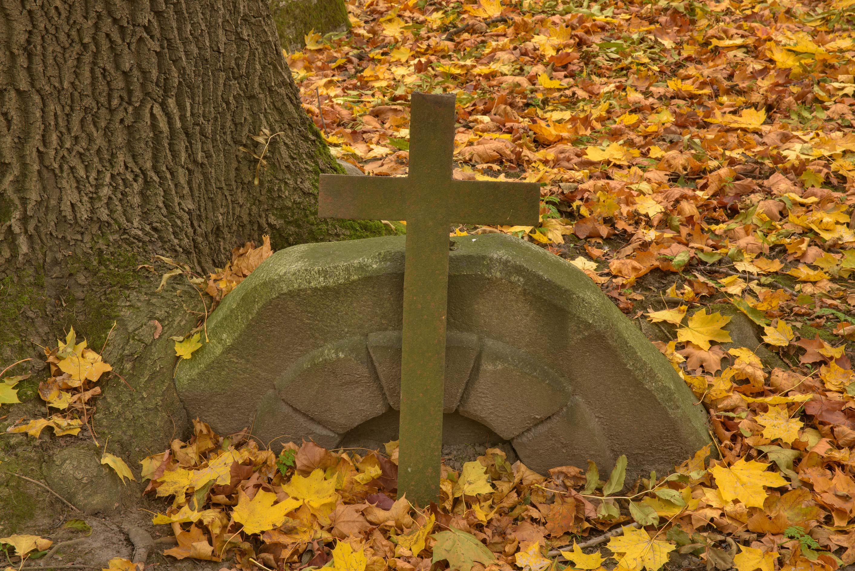 Stone cross on Actor Lane in Literatorskie Mostki...Cemetery. St.Petersburg, Russia
