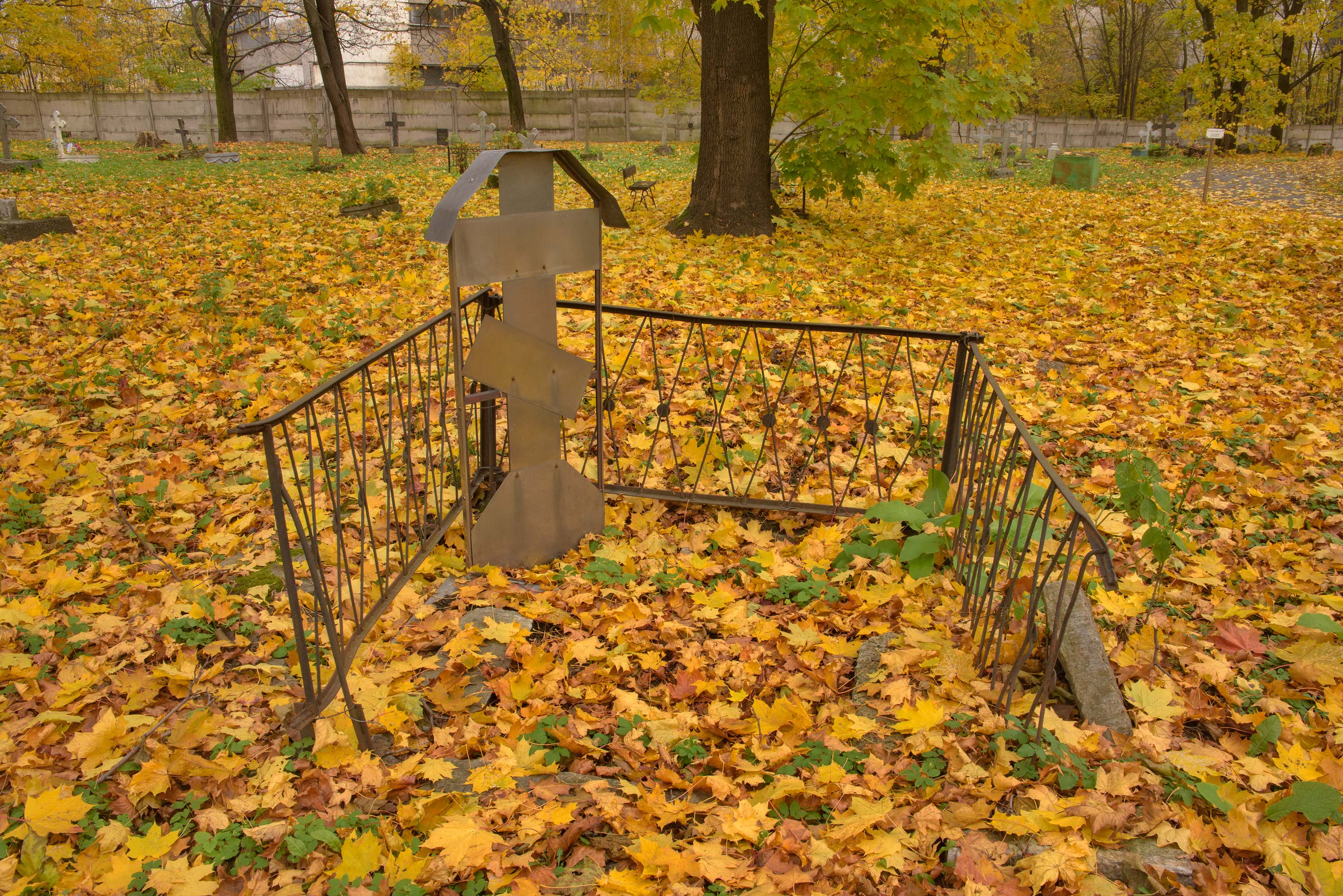 Unmarked tomb with an iron cross in Novodevichye...Prospect. St.Petersburg, Russia